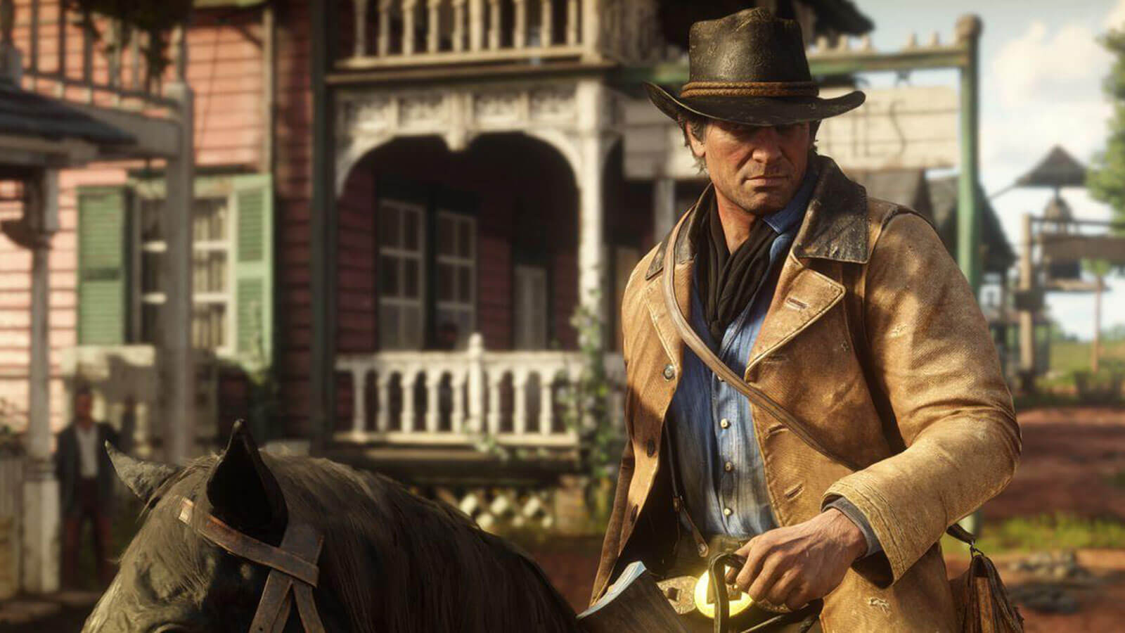 Red Dead Redemption 2's protagonist Arthur Morgan rides into town on his horse.