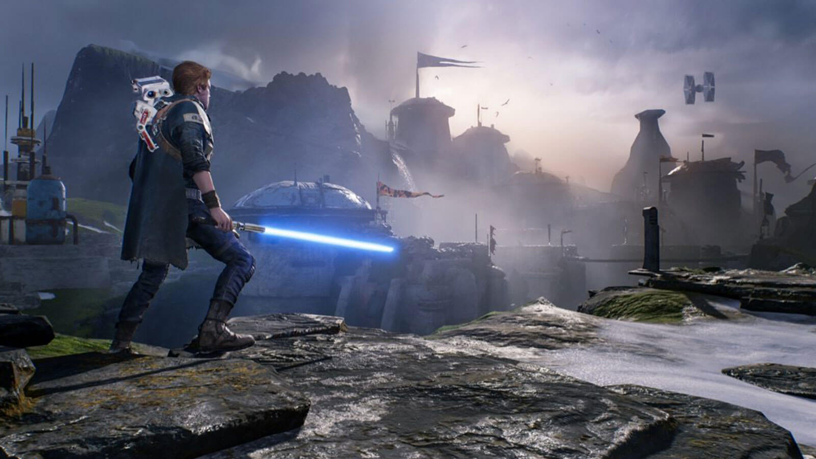 Star Wars Jedi: Fallen Order's hero, Cal Kestis, wields his lightsaber and looks out at a rocky landscape while a small droid rides on his back.