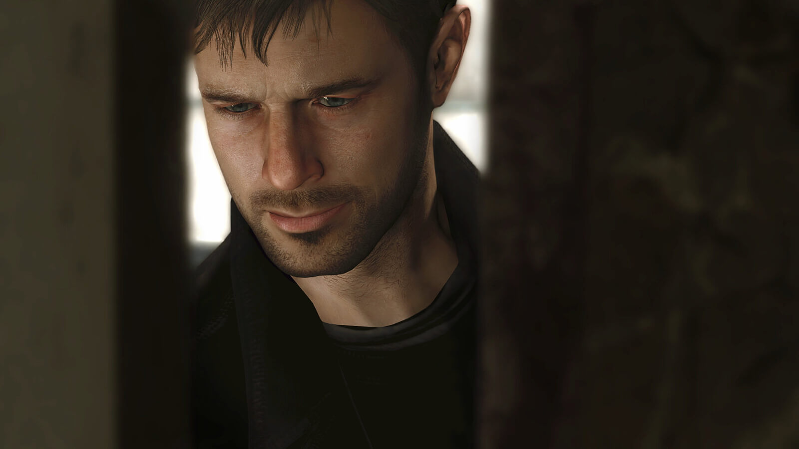 Closeup on the face of a computer-generated man in a black coat, looking down, as seen through a narrow vertical opening.