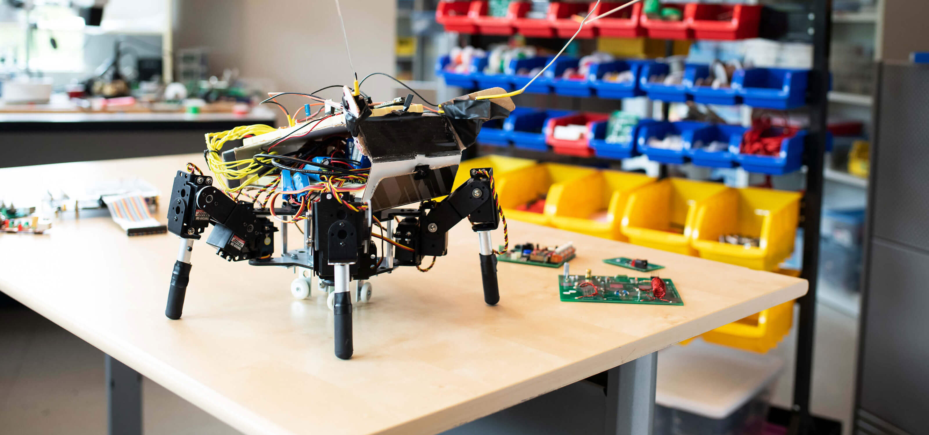 A robot sits on a table in the DigiPen computer engineering lab
