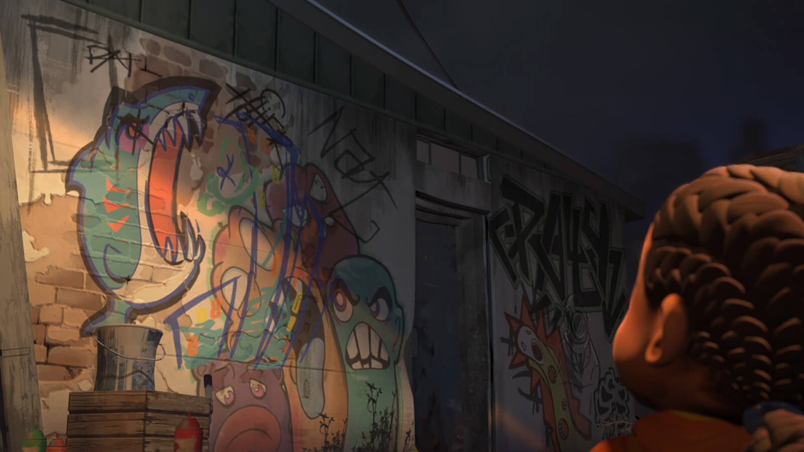A young girl from behind looking at a dimly lit exterior wall covered in colorful graffiti