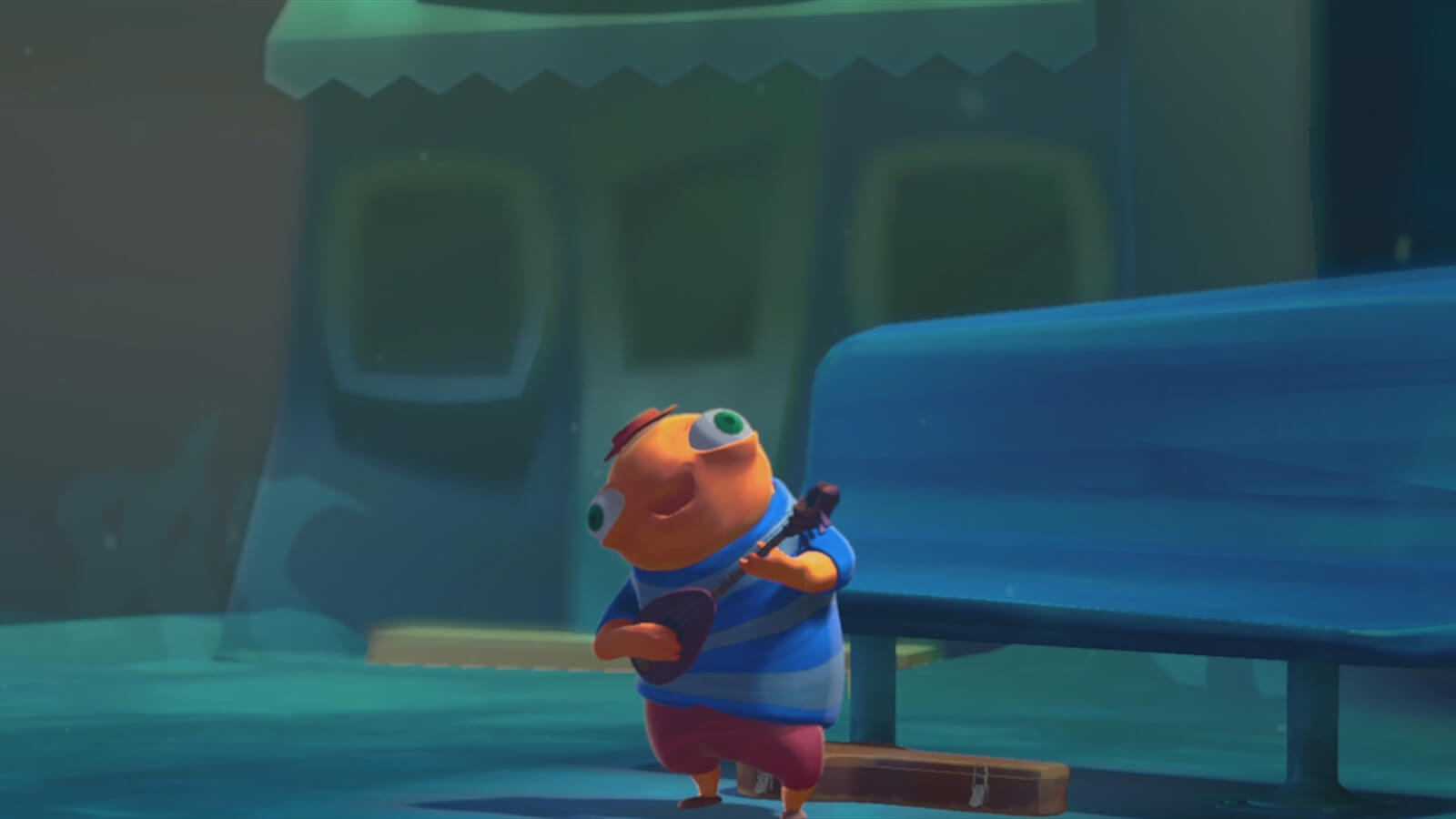 An orange fish in a red cap and striped blue t-shirt and holding happily plays a guitar-like instrument at a bus stop