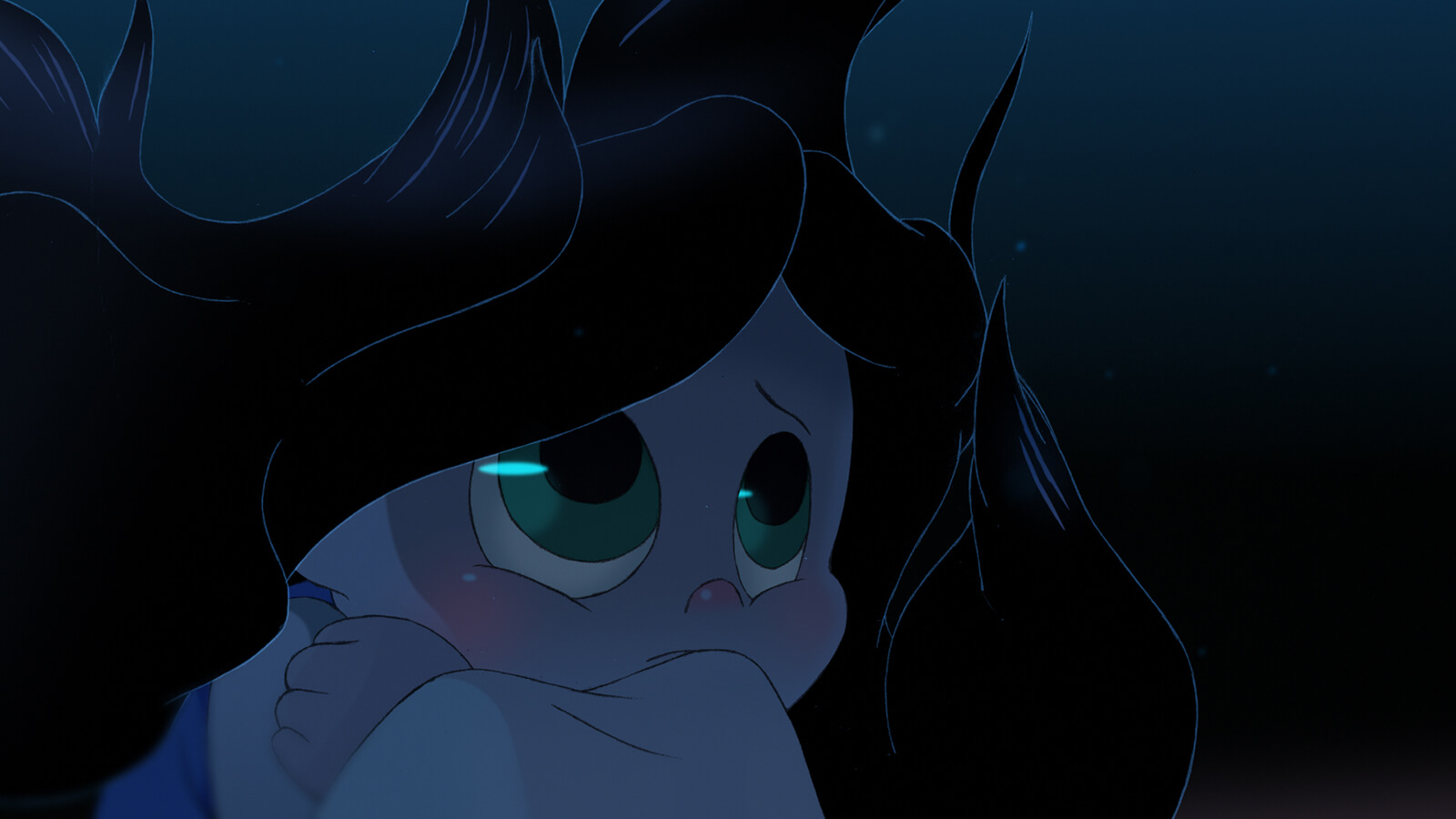A girl with green eyes is deep underwater in the dark, her black hair floating around her as she looks up