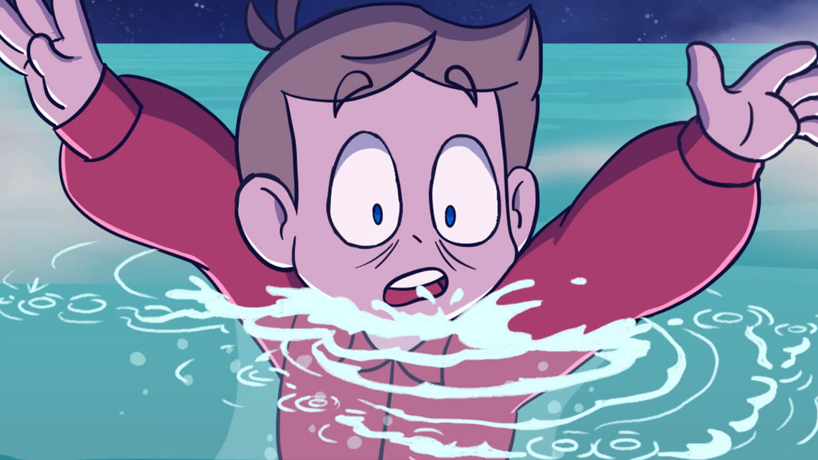 A startled boy sinks beneath the surface of the ocean.