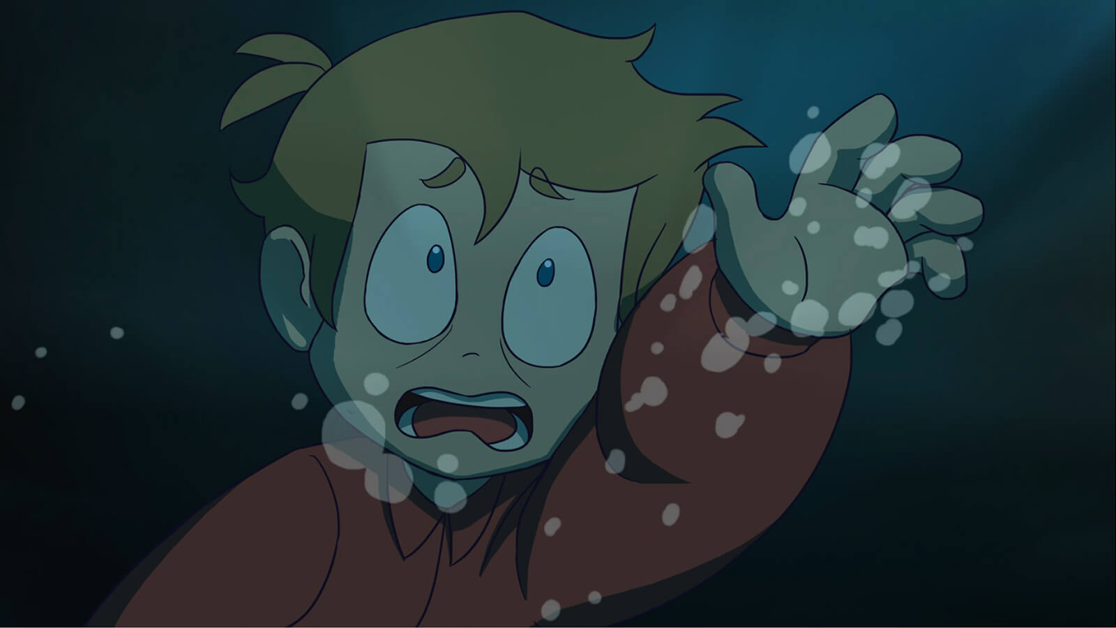 A panicked boy submerged in the ocean reaches up.