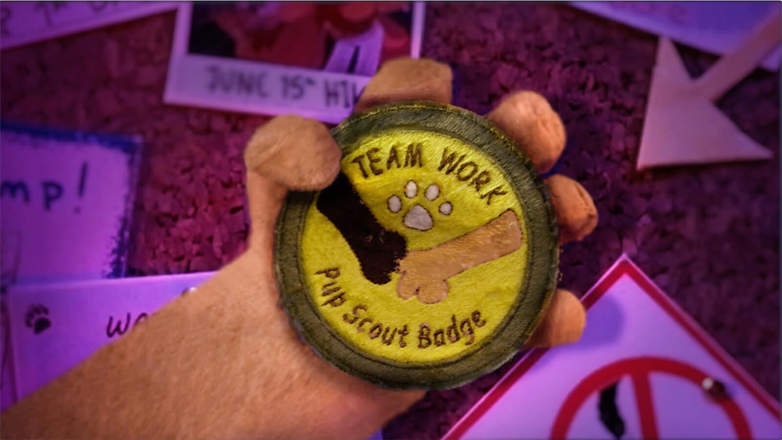 "A merit badge from the pup scouts for ""Team Work."""