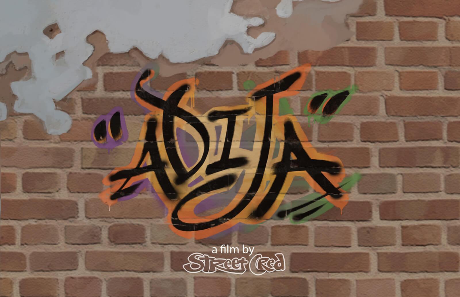 "A title card reading ""Adija"" in stylized black and orange script. ""A film by Street Cred"" is seen below."