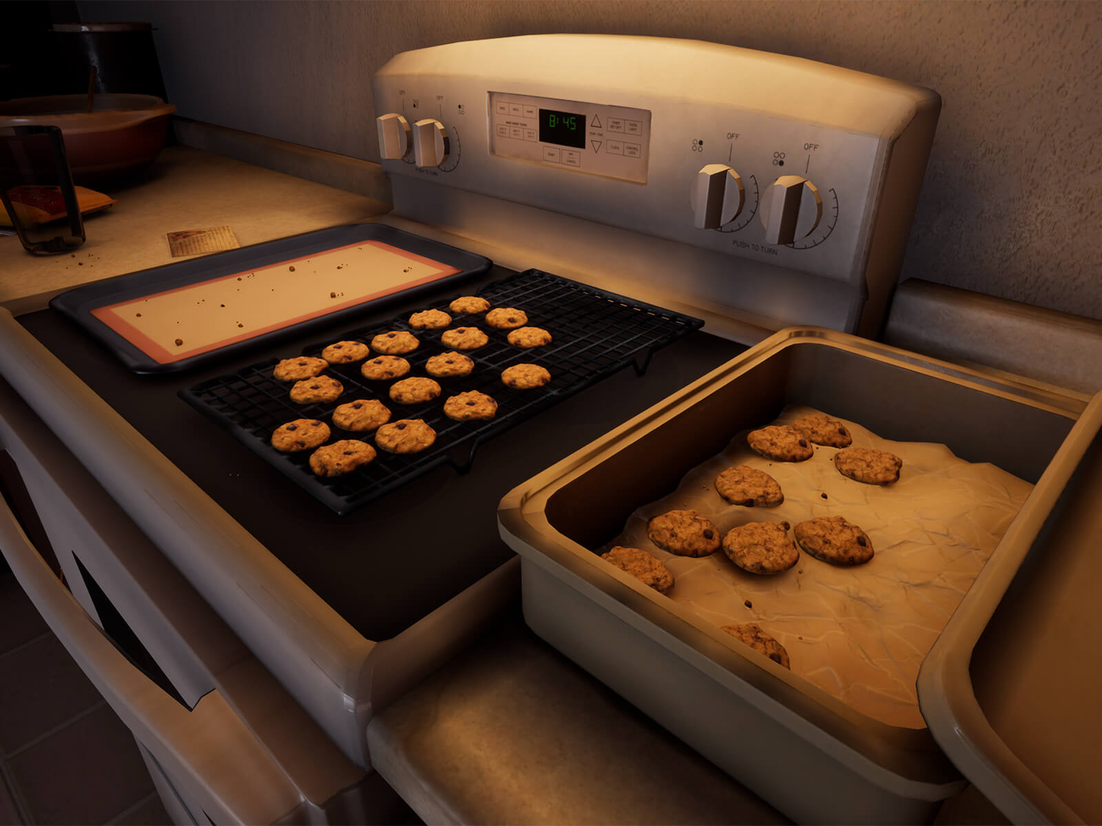 Chocolate chip cookies cooling on a rack on top of a stove