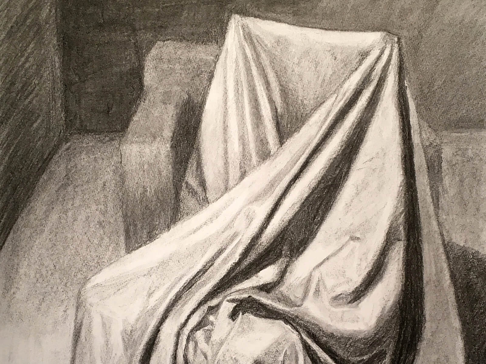 still-life drawing of a chair draped in a sheet