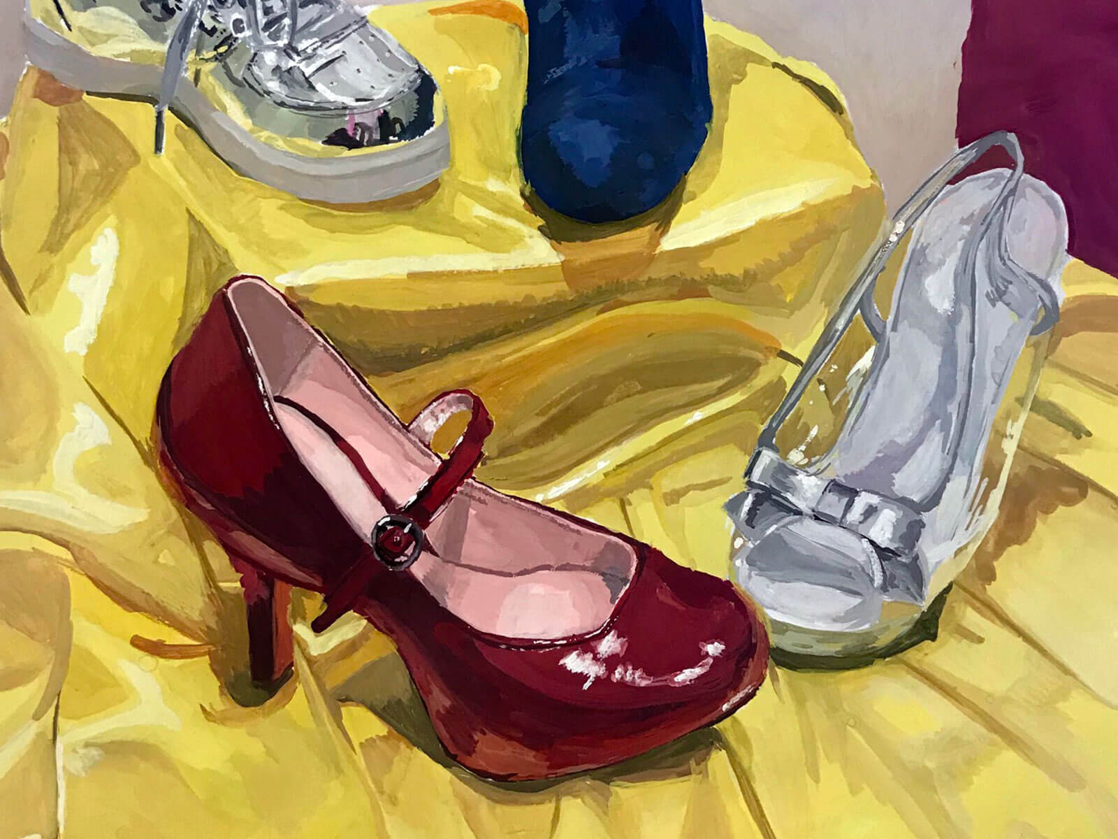 Various shoes, including high-heeled red and sliver, on a yellow cloth