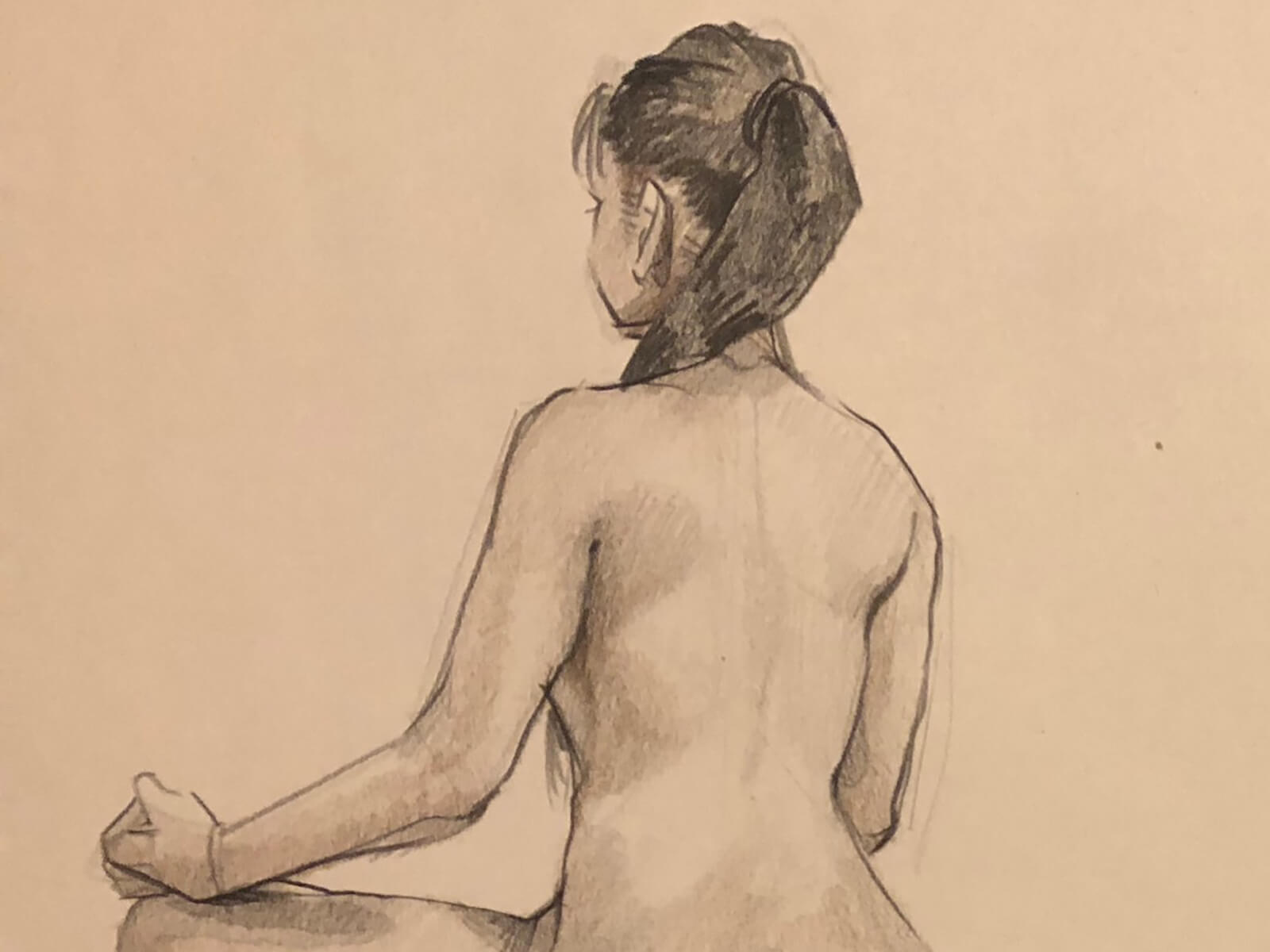 A sketch of a nude woman, sitting with her back to the artist