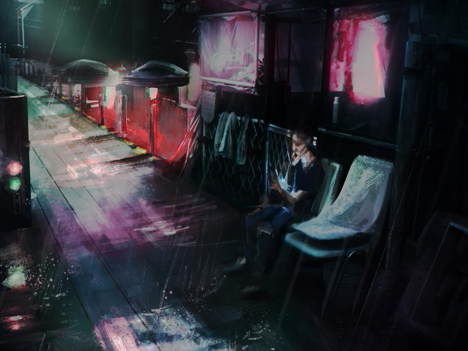 A man sits in a chair on a darkened rainy street
