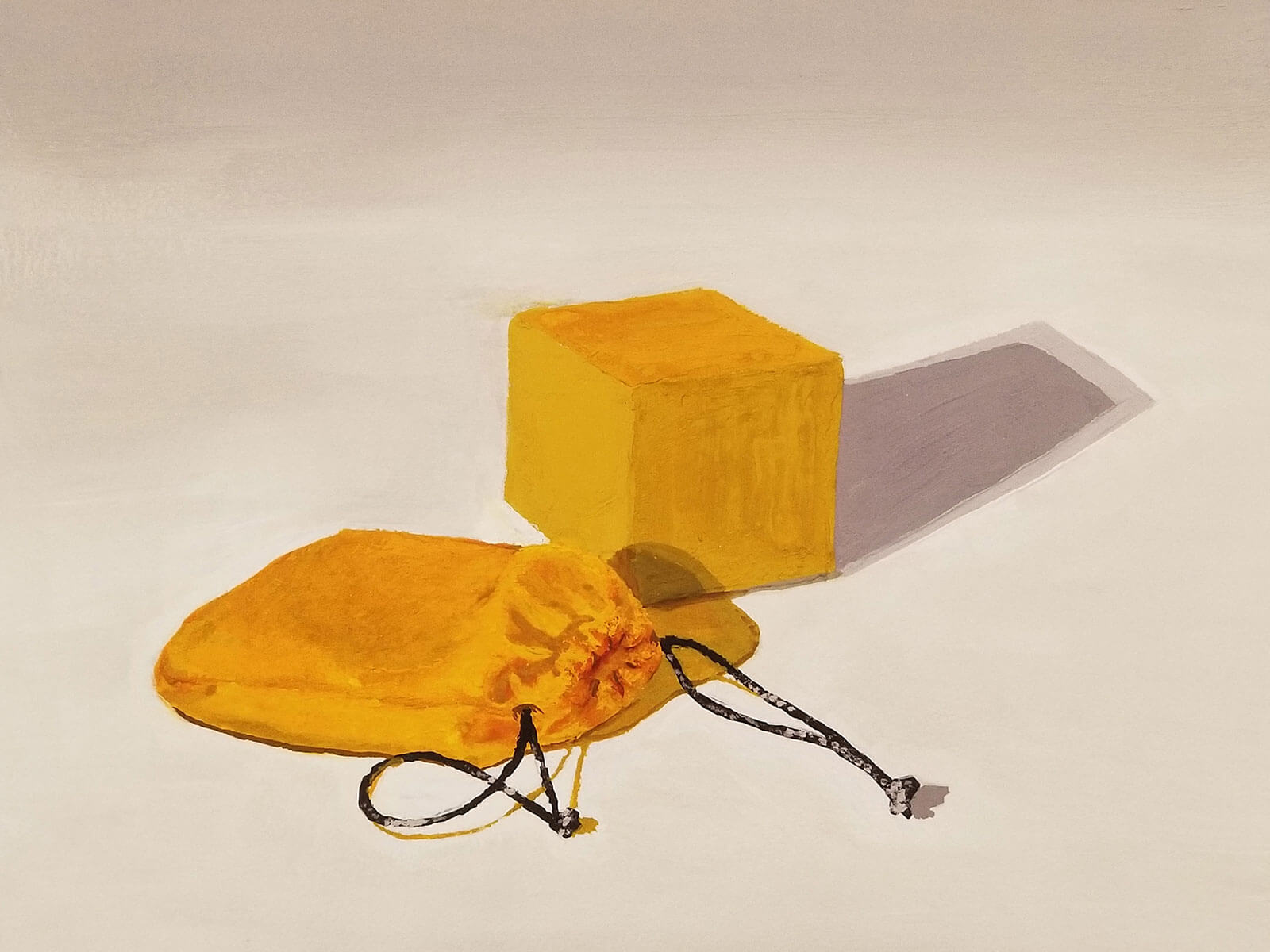 A small yellow block with a cloth pouch