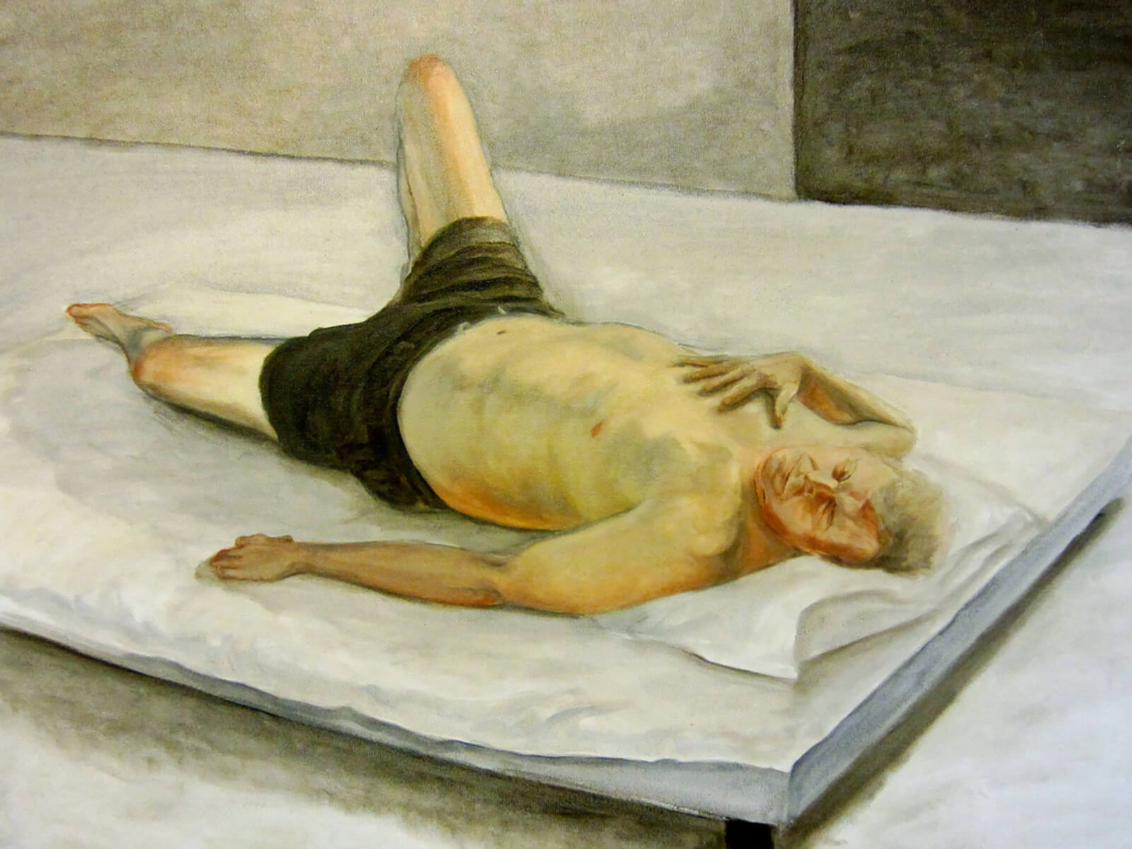 traditional painting of a bare-chested older man lying on a mattress