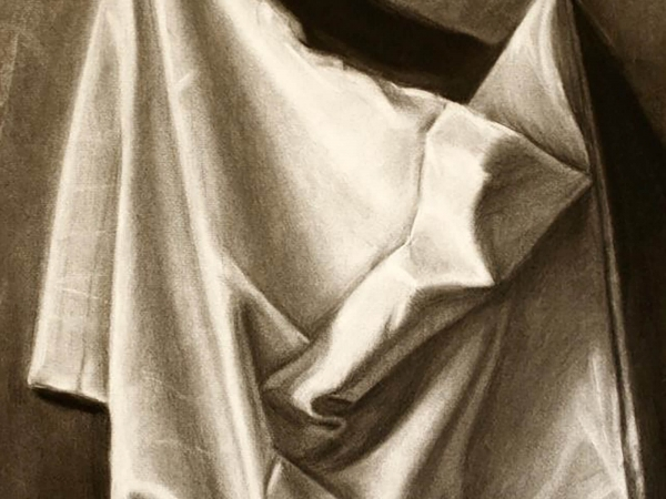 black and white drawing of a draped sheet