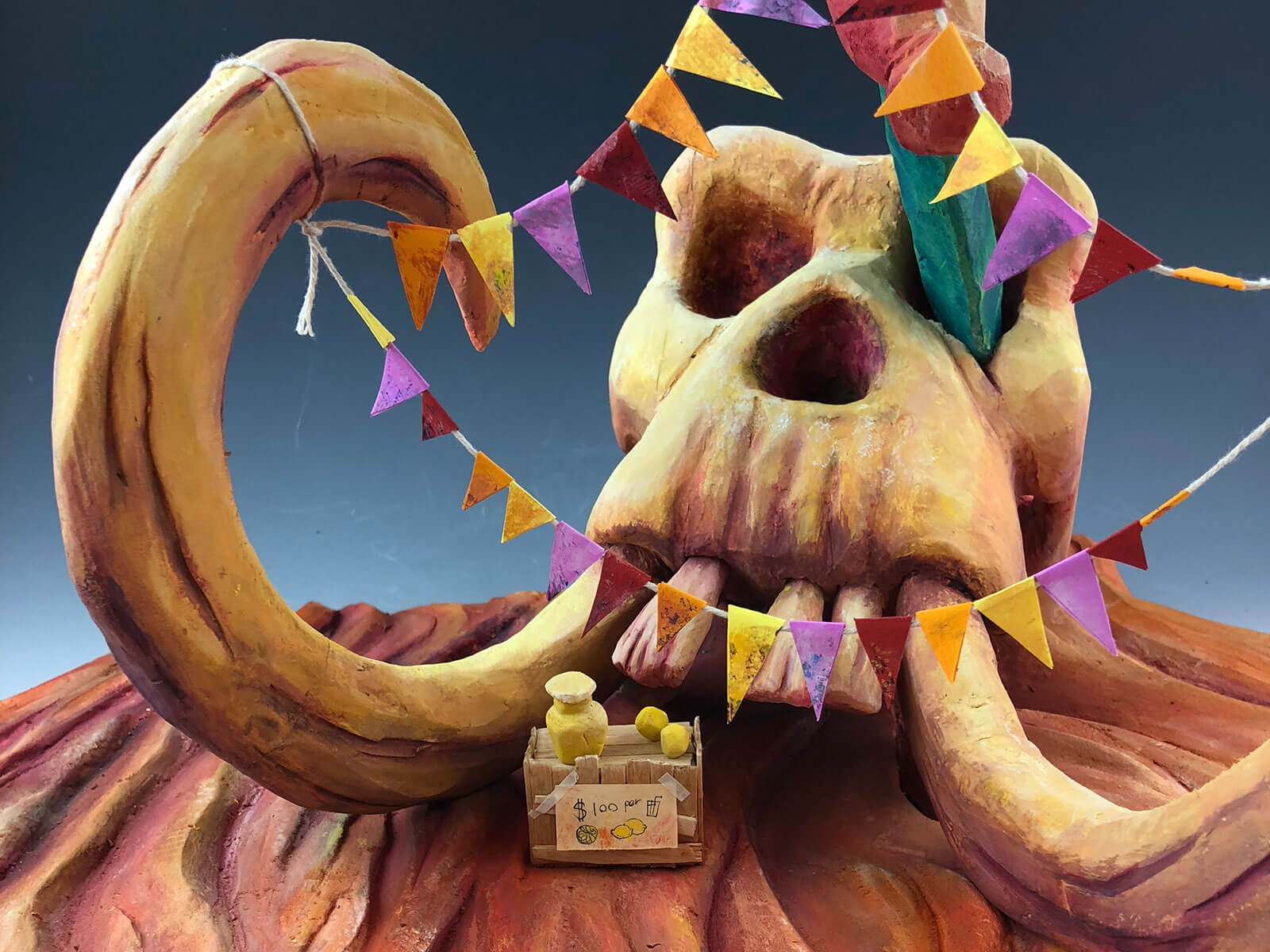 Mammoth skull draped with party flags
