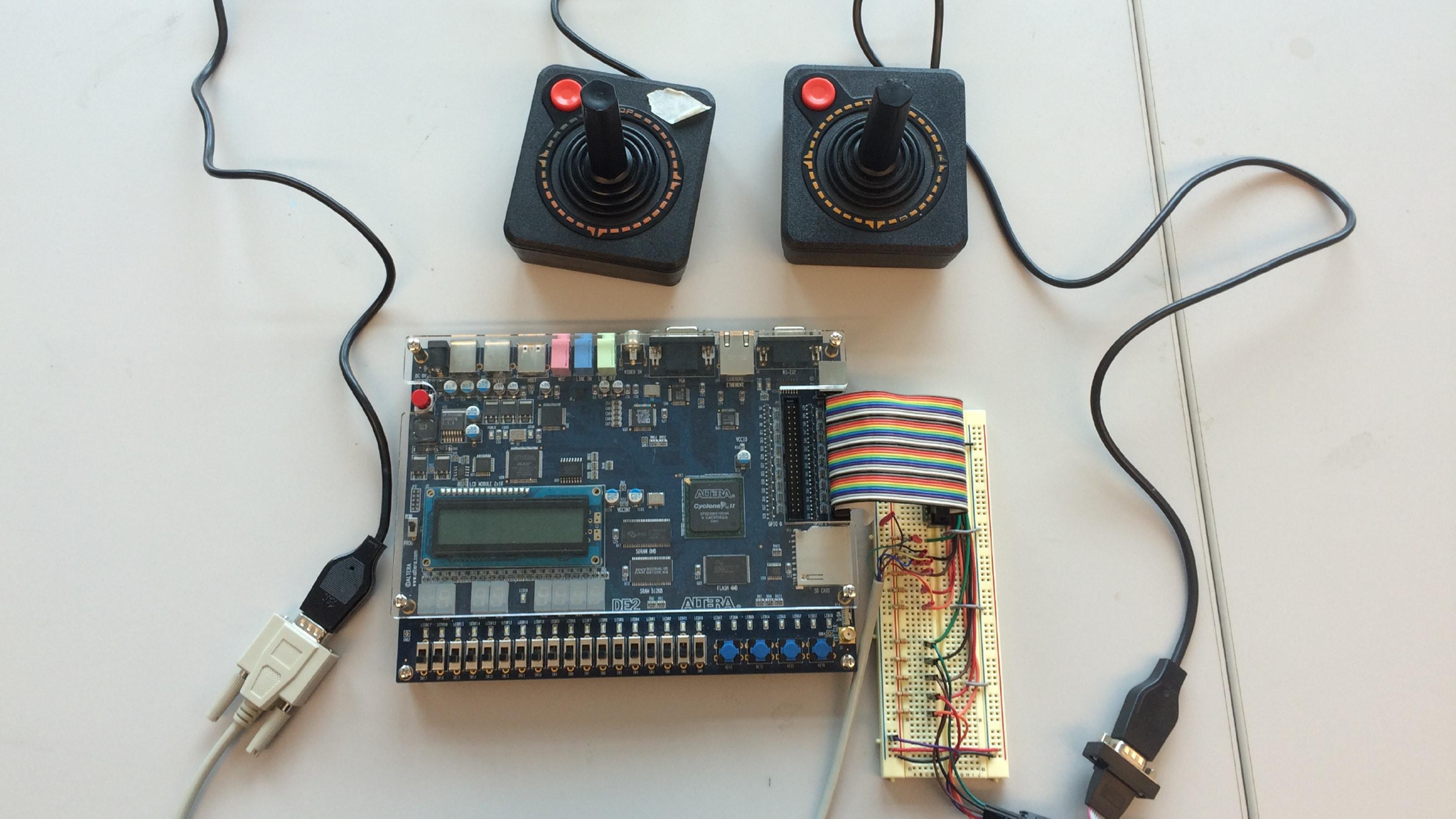 Two Atari joysticks connected to an Altera DE2 board.