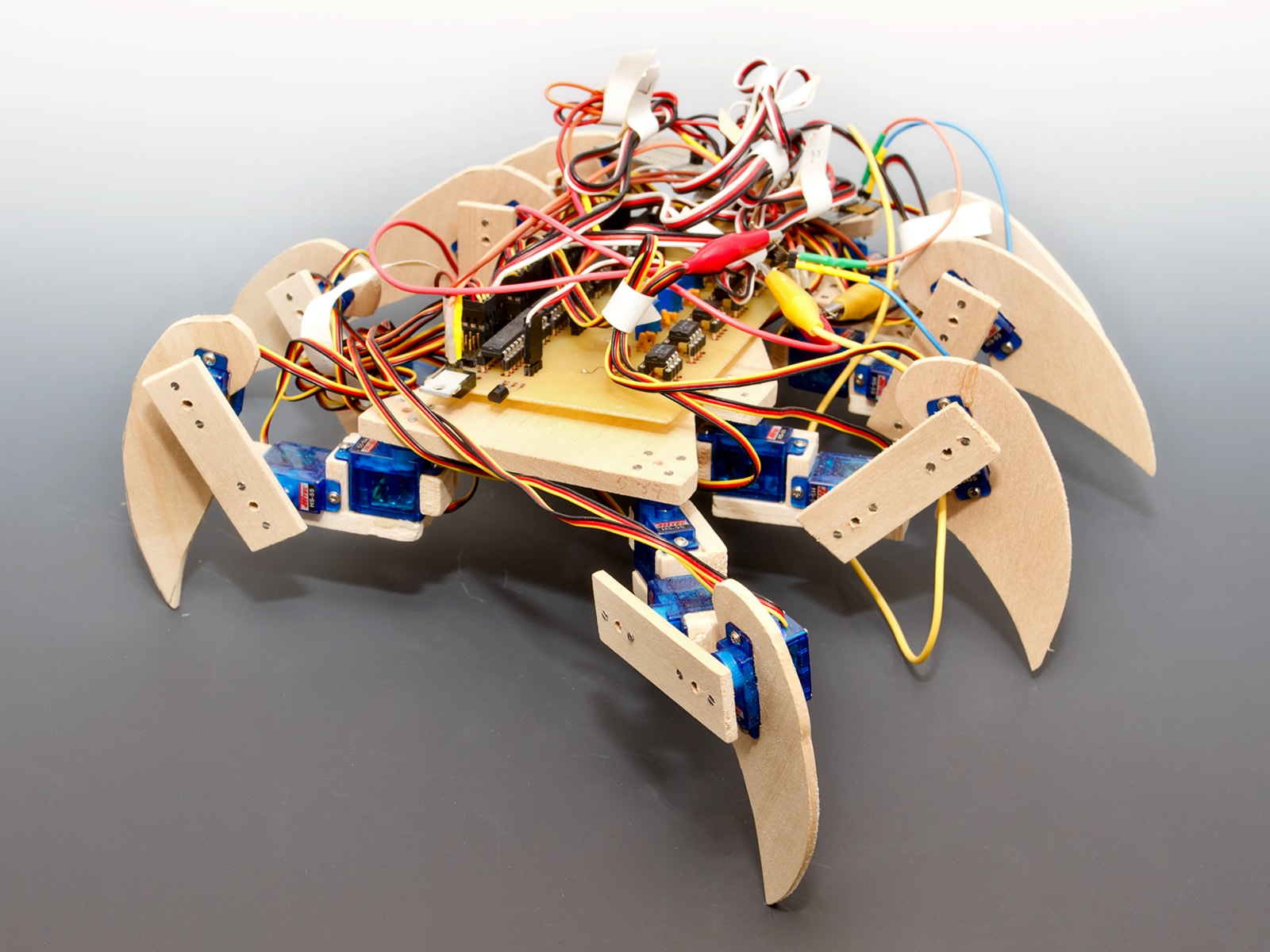 An eight-legged scorpion-like robot with exposed circuits.