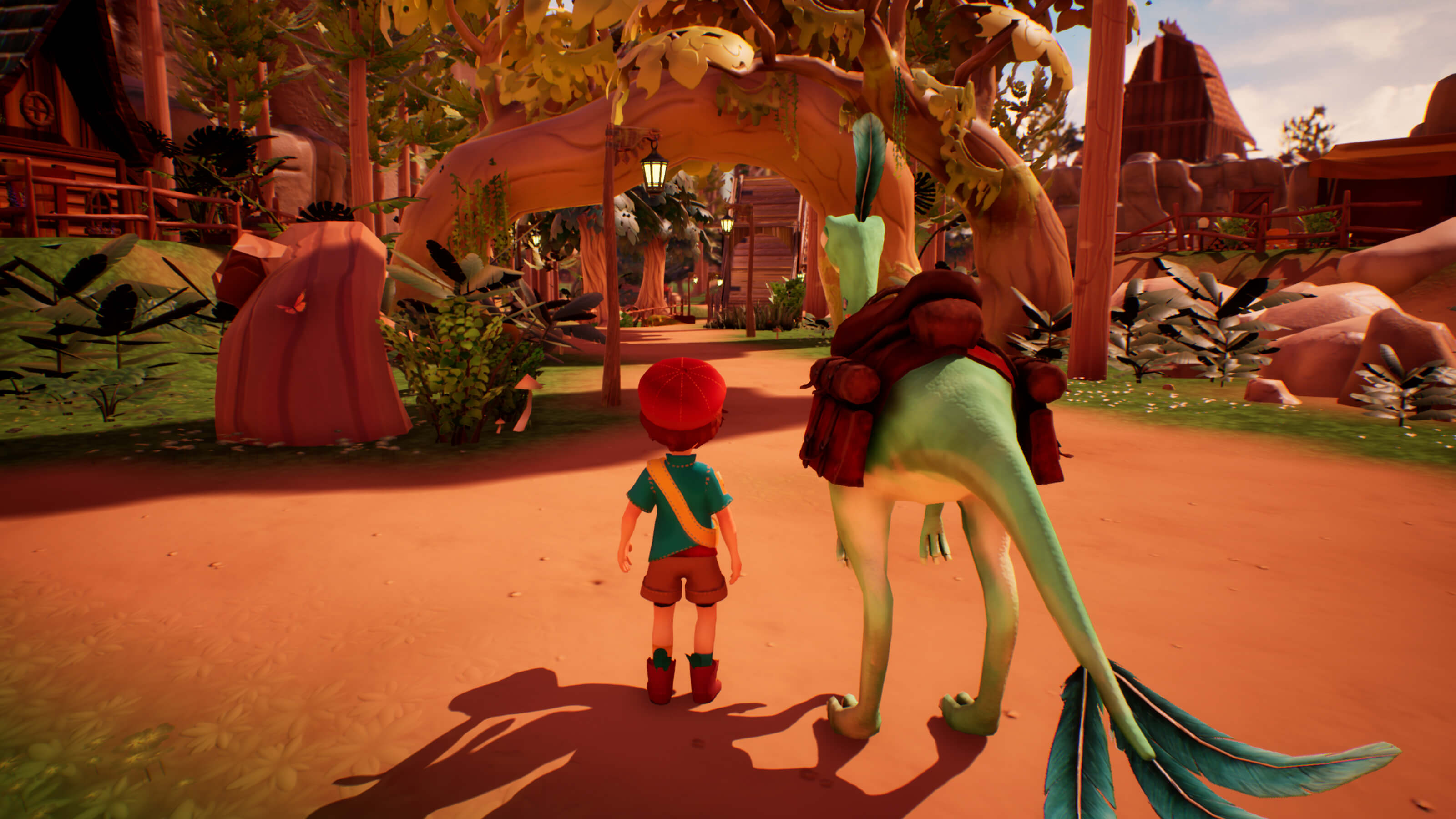 A boy stands next to his saddled-up dinosaur in the town of Cretaceous Cliffs.