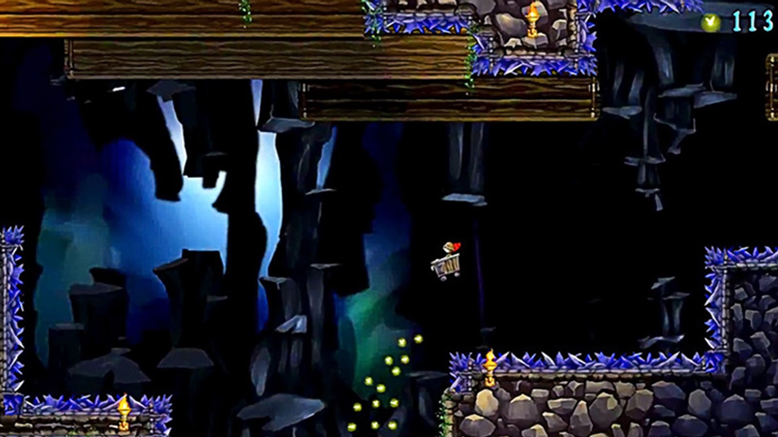 A caped boy riding a mine cart soars through the air in a large underground cavern.