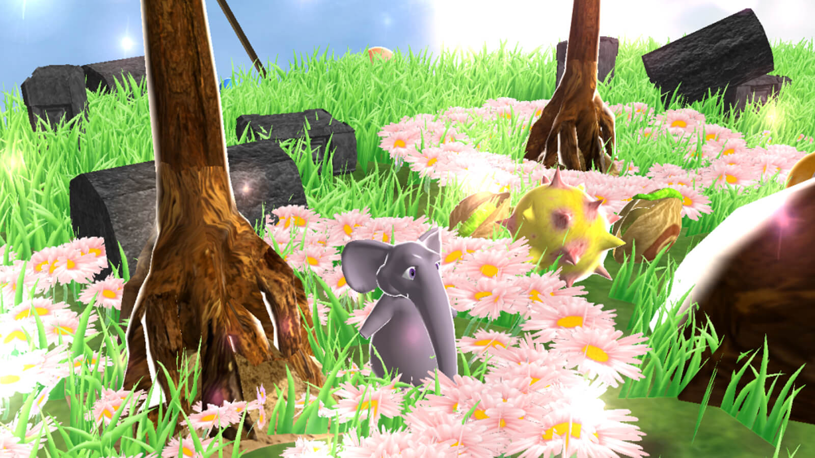 An elephant stands in a field of pink flowers.