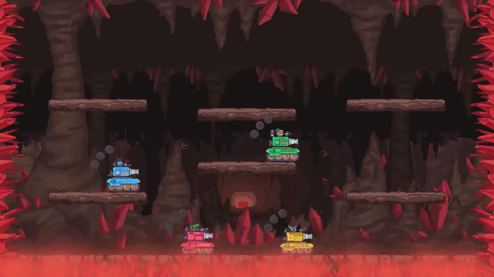 A green, yellow, blue and red tank fight in a room of sharp red crystals.