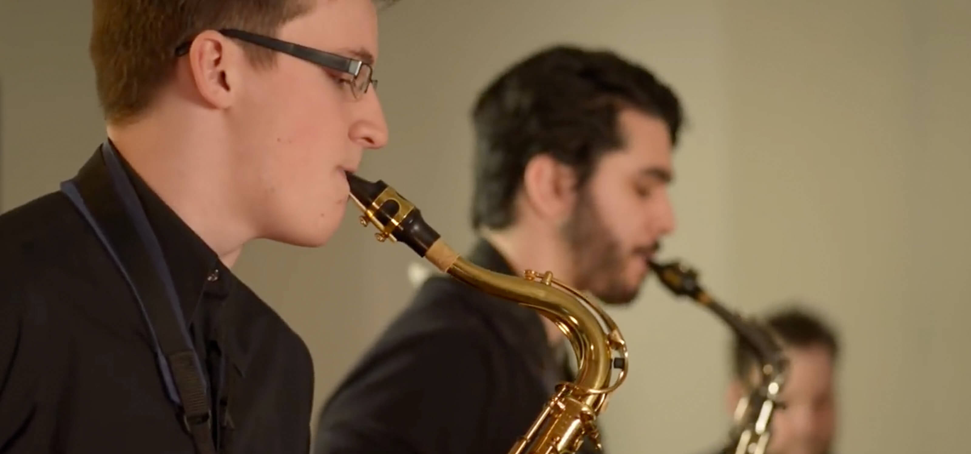 Screenshot from the DigiPen Jazz video All Good, featuring students playing saxophones
