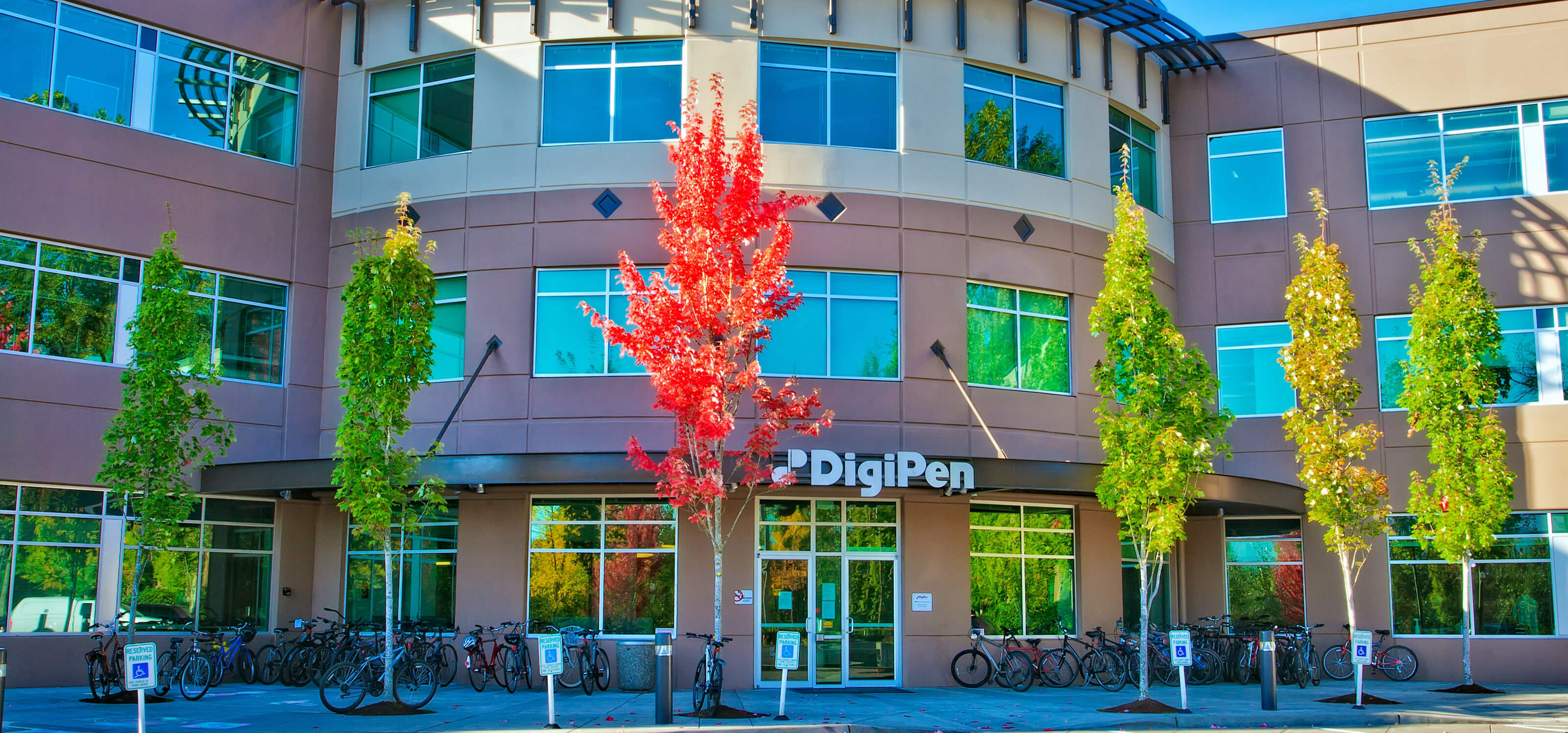 Close-up of the DigiPen front entrance on a sunny autumn day