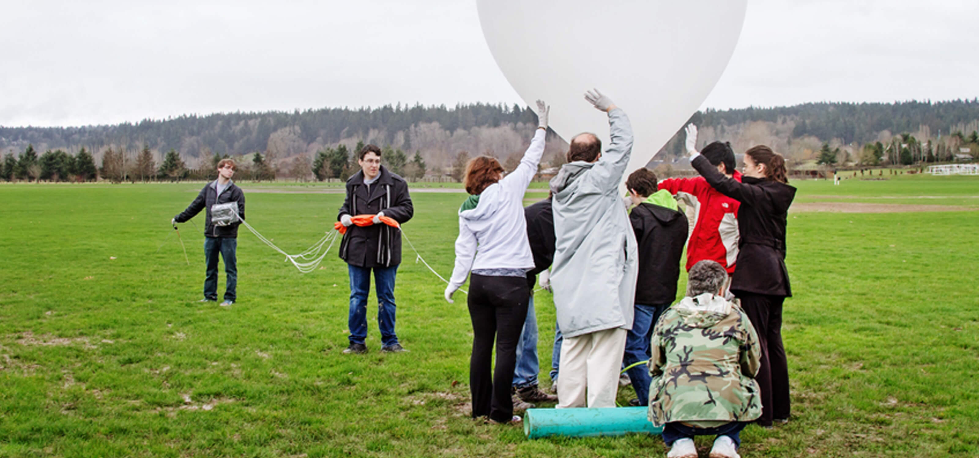 DigiPen students launching a large high-altitude balloon at 60 Acres Park in Redmond