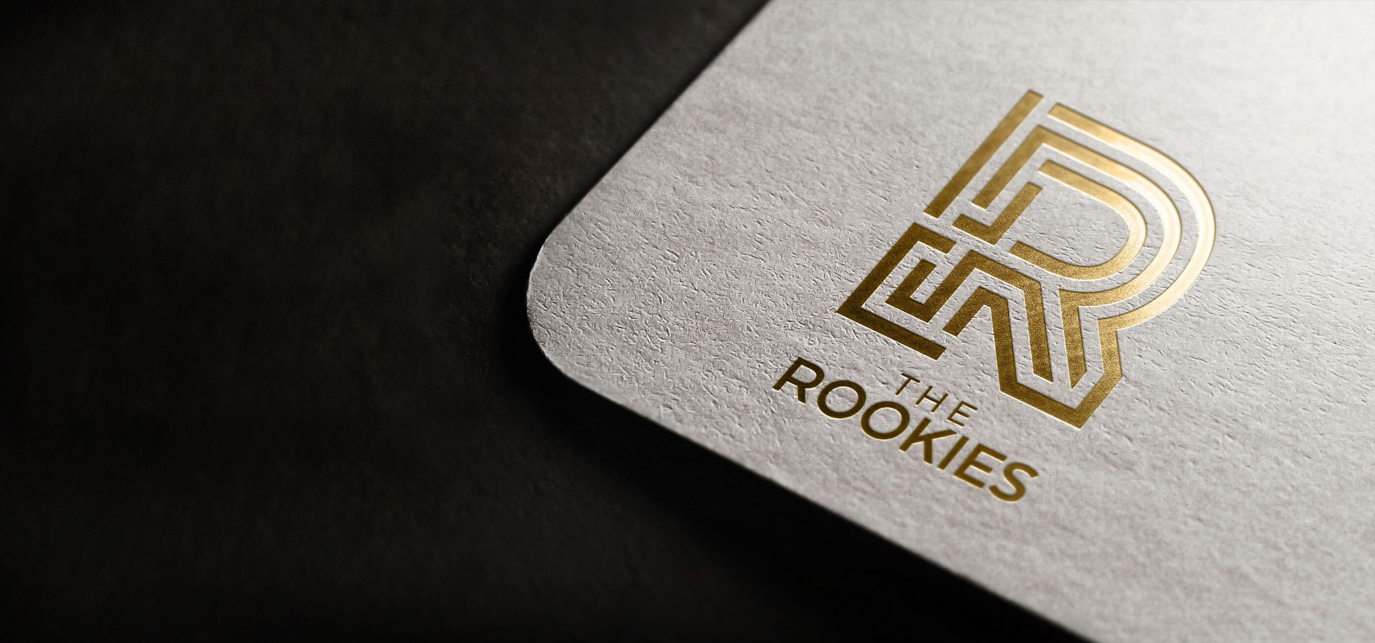 """The black and white """"R"""" logo for The Rookie Awards."""