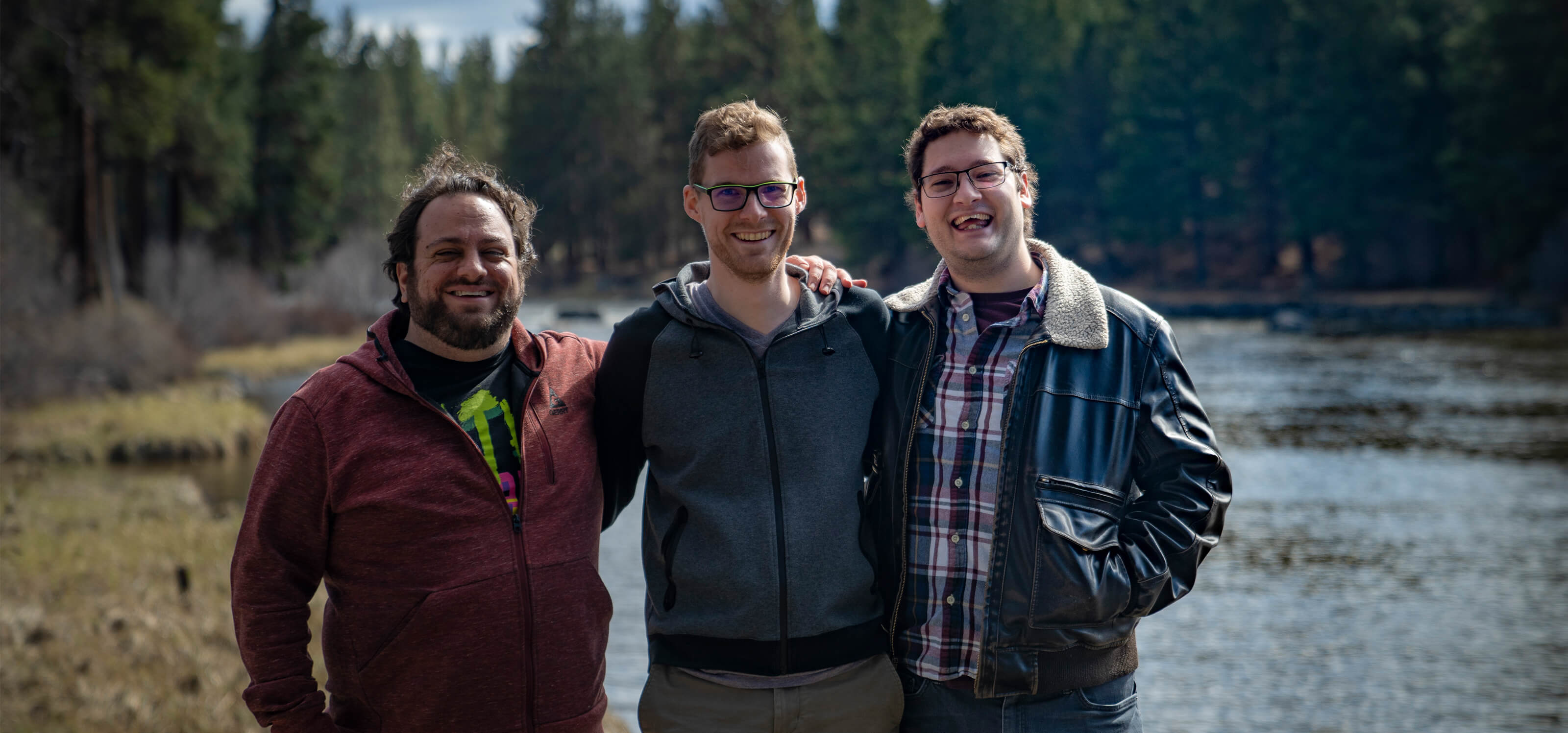 Jacob Fieth, Geoffry Hammon, and Sawyer Paradise pose on the Deschutes River near SIE Bend Studio's offices.