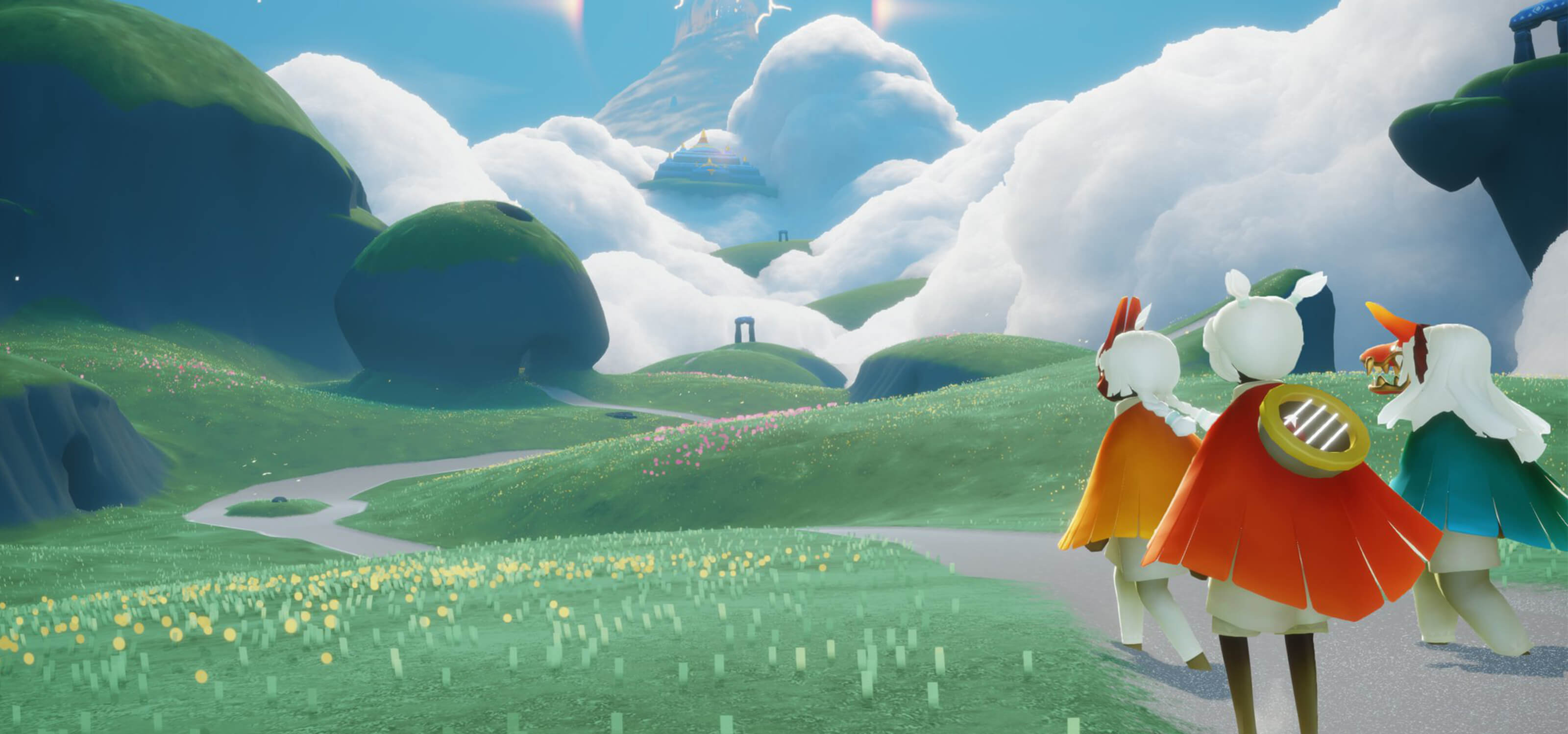 Three characters from Sky: Children of the Light look out at rolling green fields.