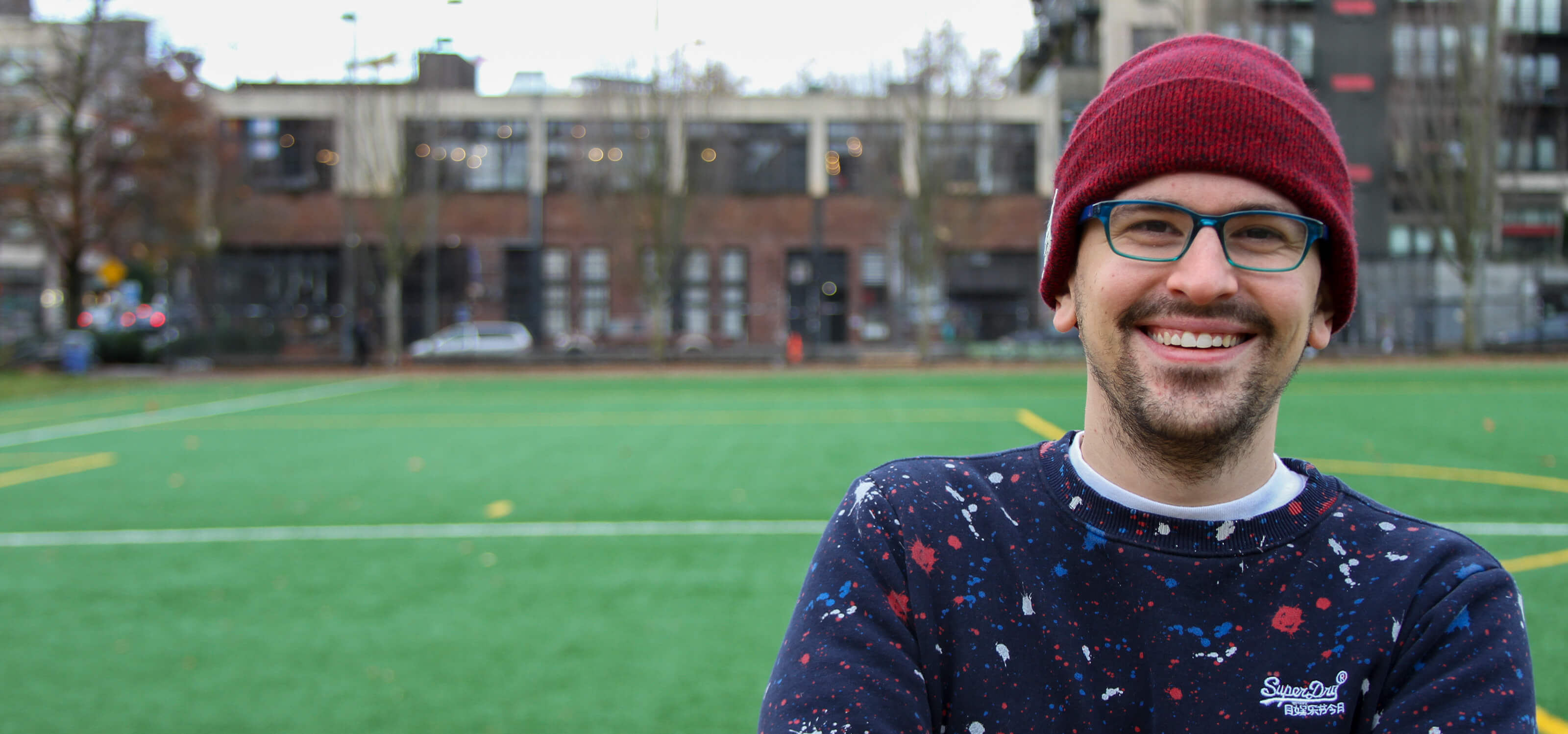 DigiPen game design graduate Logan Fieth smiles for the camera in Seattle's Cal Anderson Park.