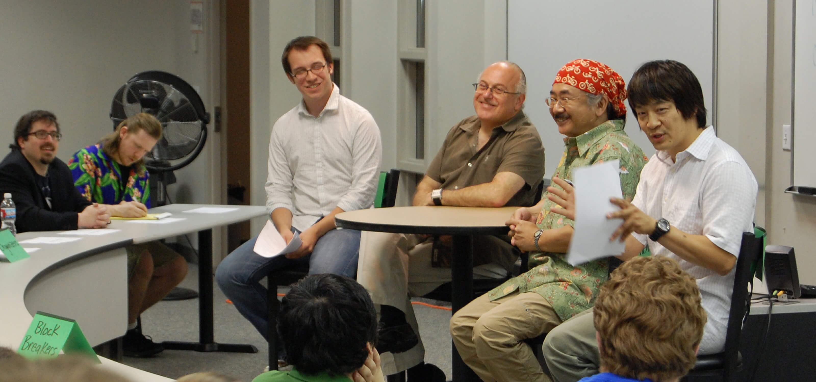 Nobuo Uematsu and Arnie Roth speak to students in a DigiPen classroom