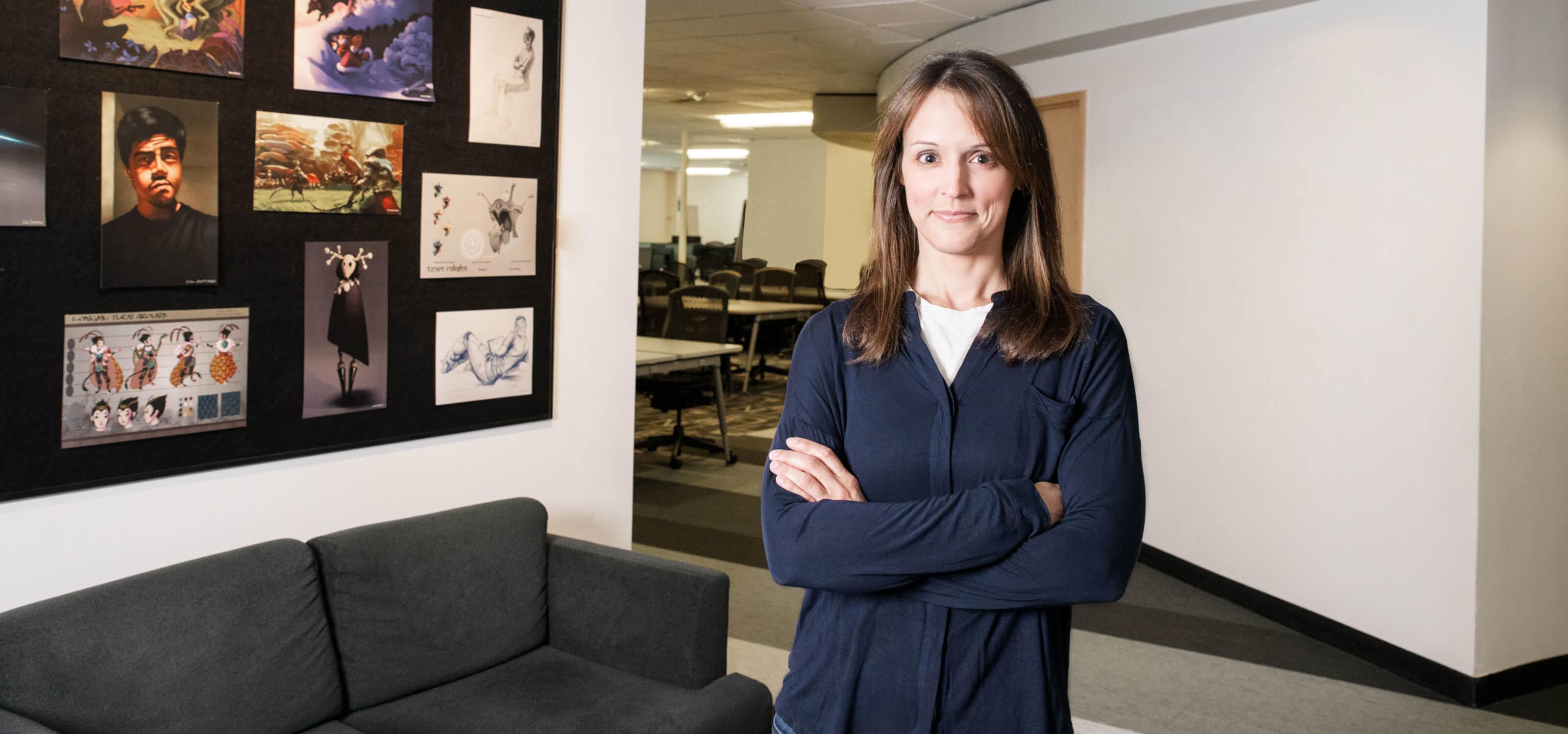 Professor Vanessa Hemovich poses for the camera in a DigiPen hallway.