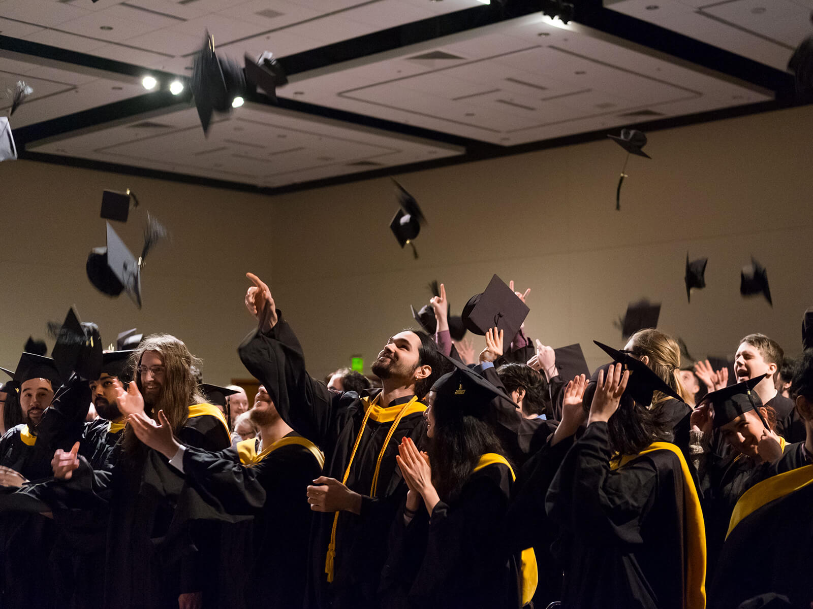 DigiPen 2017 graduates toss their caps in the air