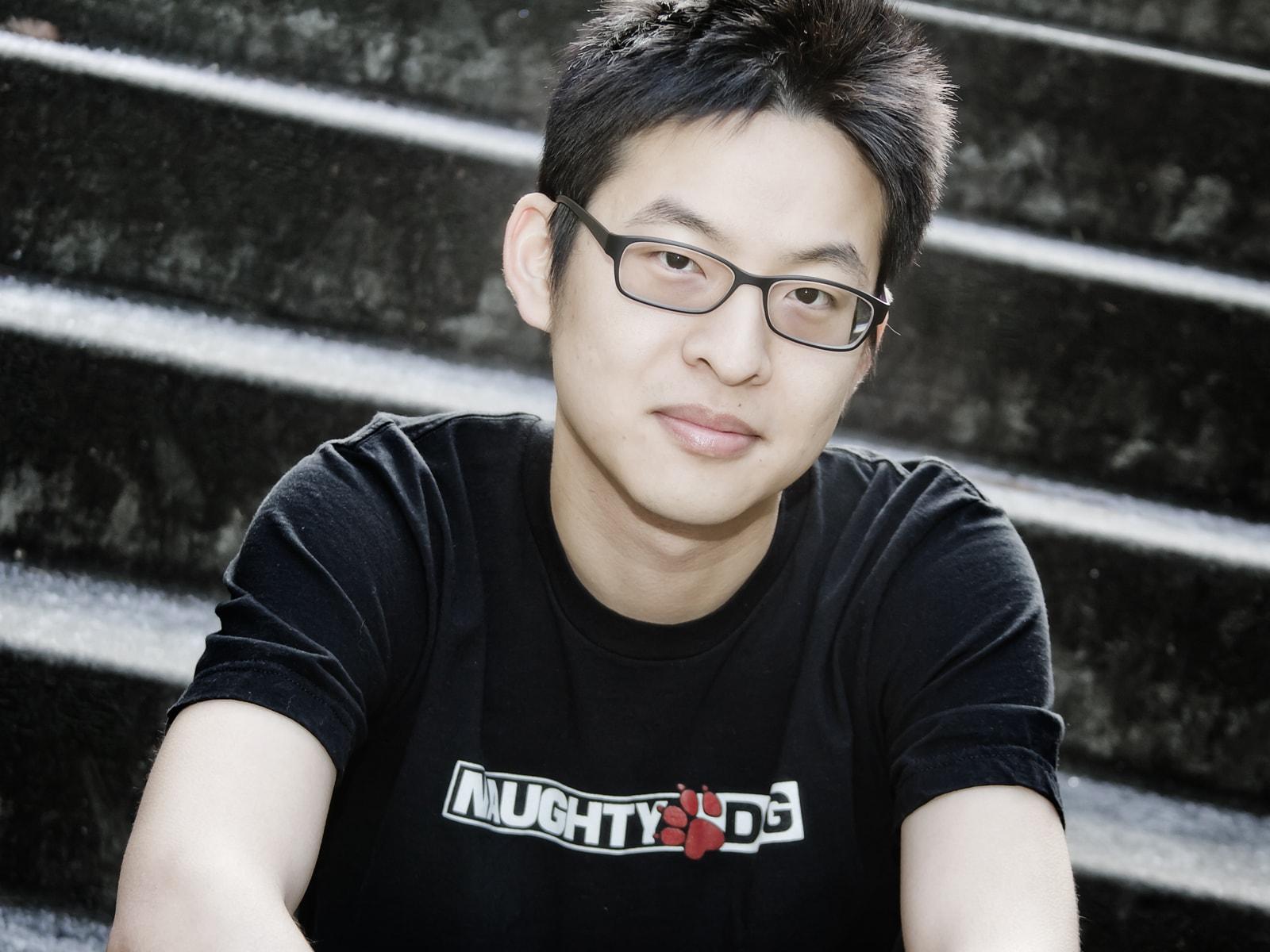 DigiPen RTIS alumnus Allen Chou sitting on stairs on the DigiPen campus