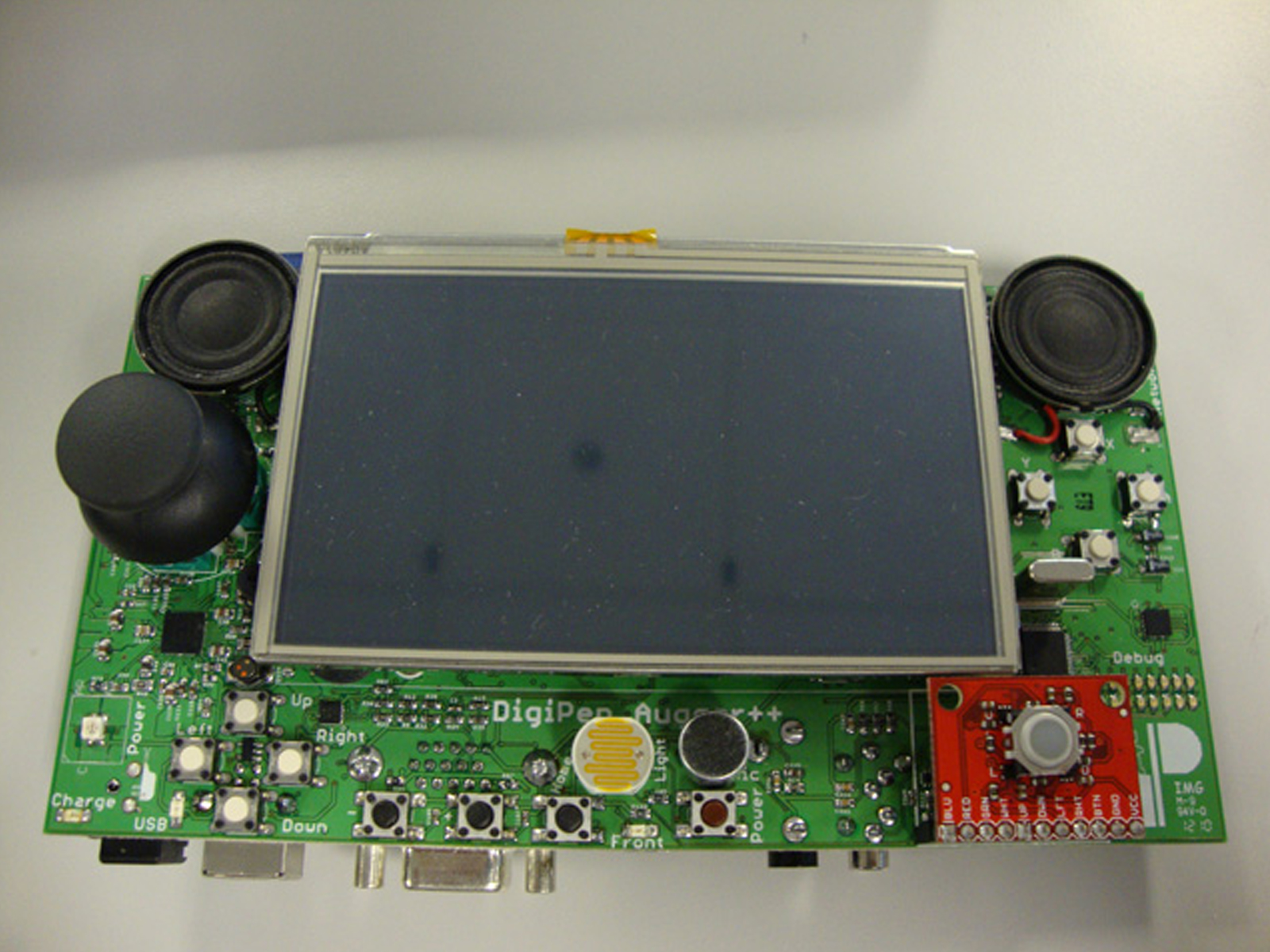 Picture of the Augger, an original handheld gaming device DigiPen alumnus Chris Clark helped design and build