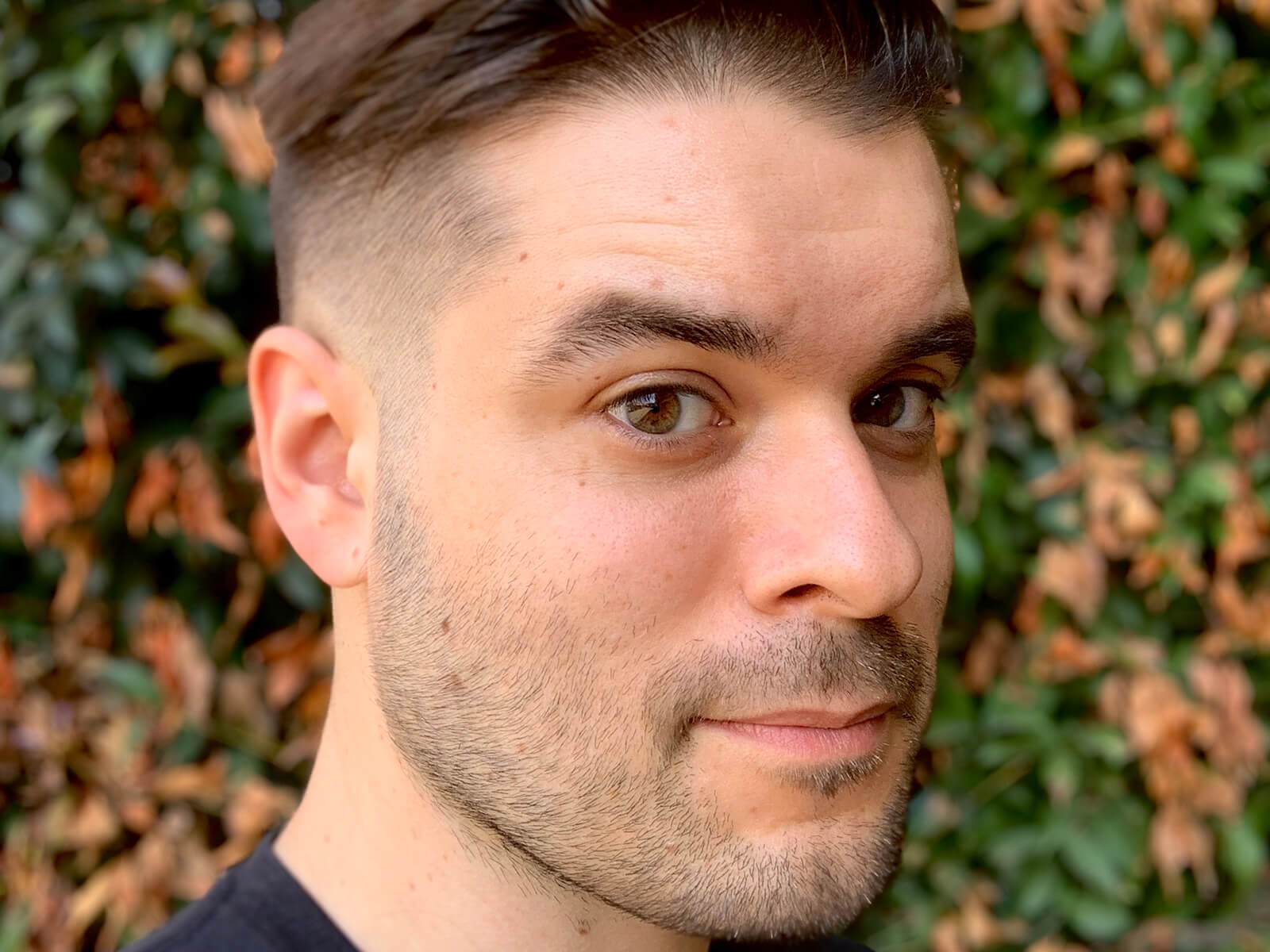 A headshot of DigiPen BFA graduate and Warner Bros. Animation director Cole Harrington.