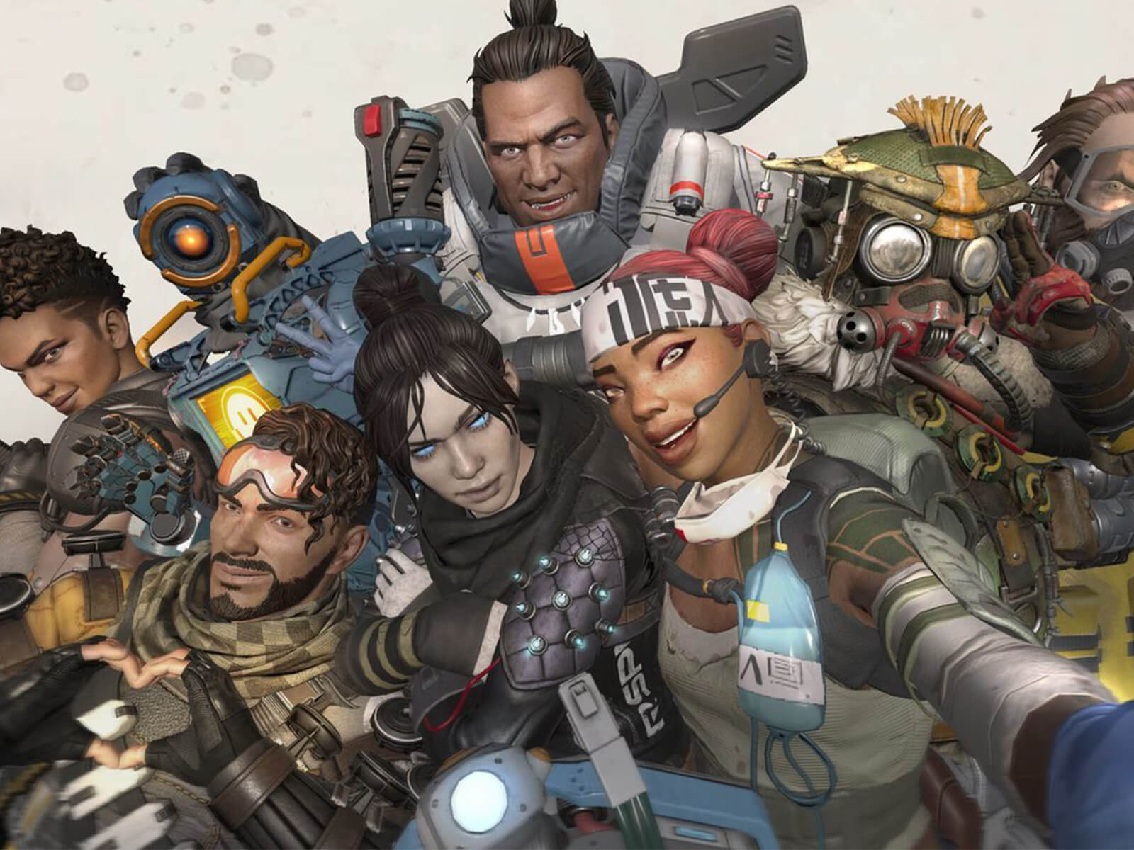 The characters from Apex Legends pose for a selfie.