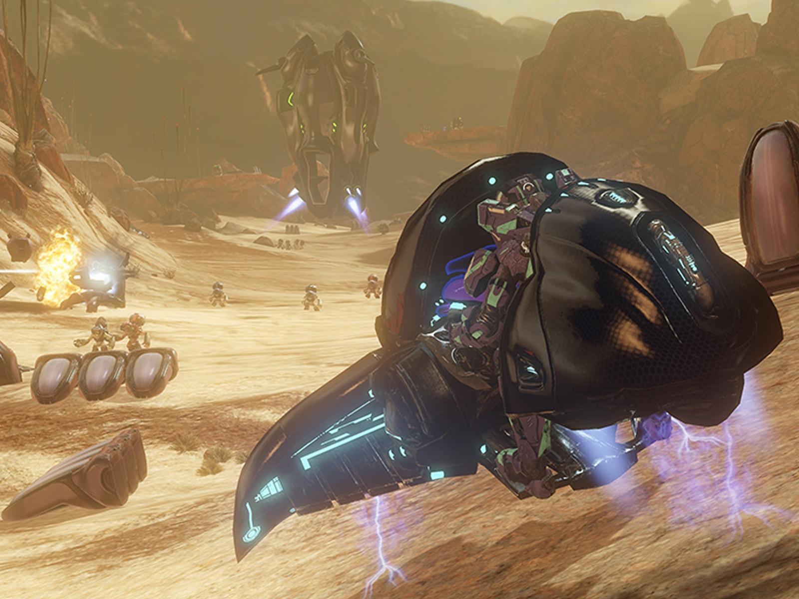 Screenshot from Halo 4 of futuristic machines flying through a mountainous desert