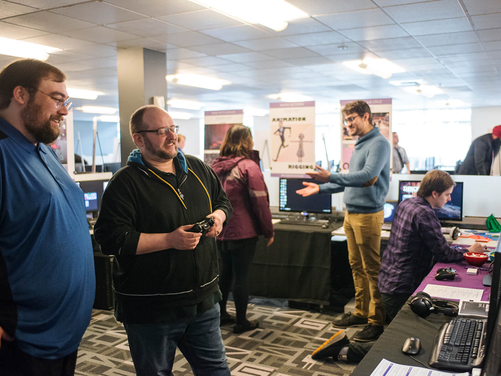 Two employers playing a student game at the 2018 DigiPen Career Fair