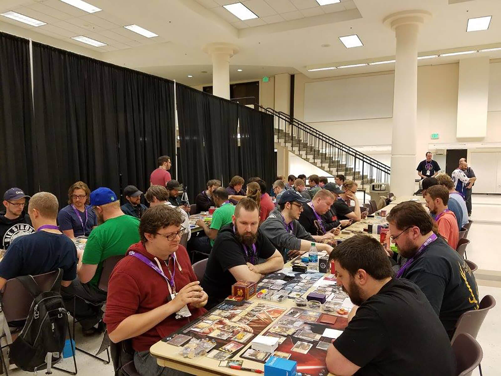 Picture from previous Evergreen Tabletop Expo featuring attendees playing board games