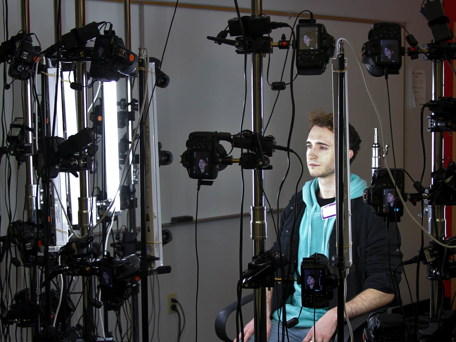 A DigiPen student gets their face scanned by Undead Labs' photogrammetry rig.