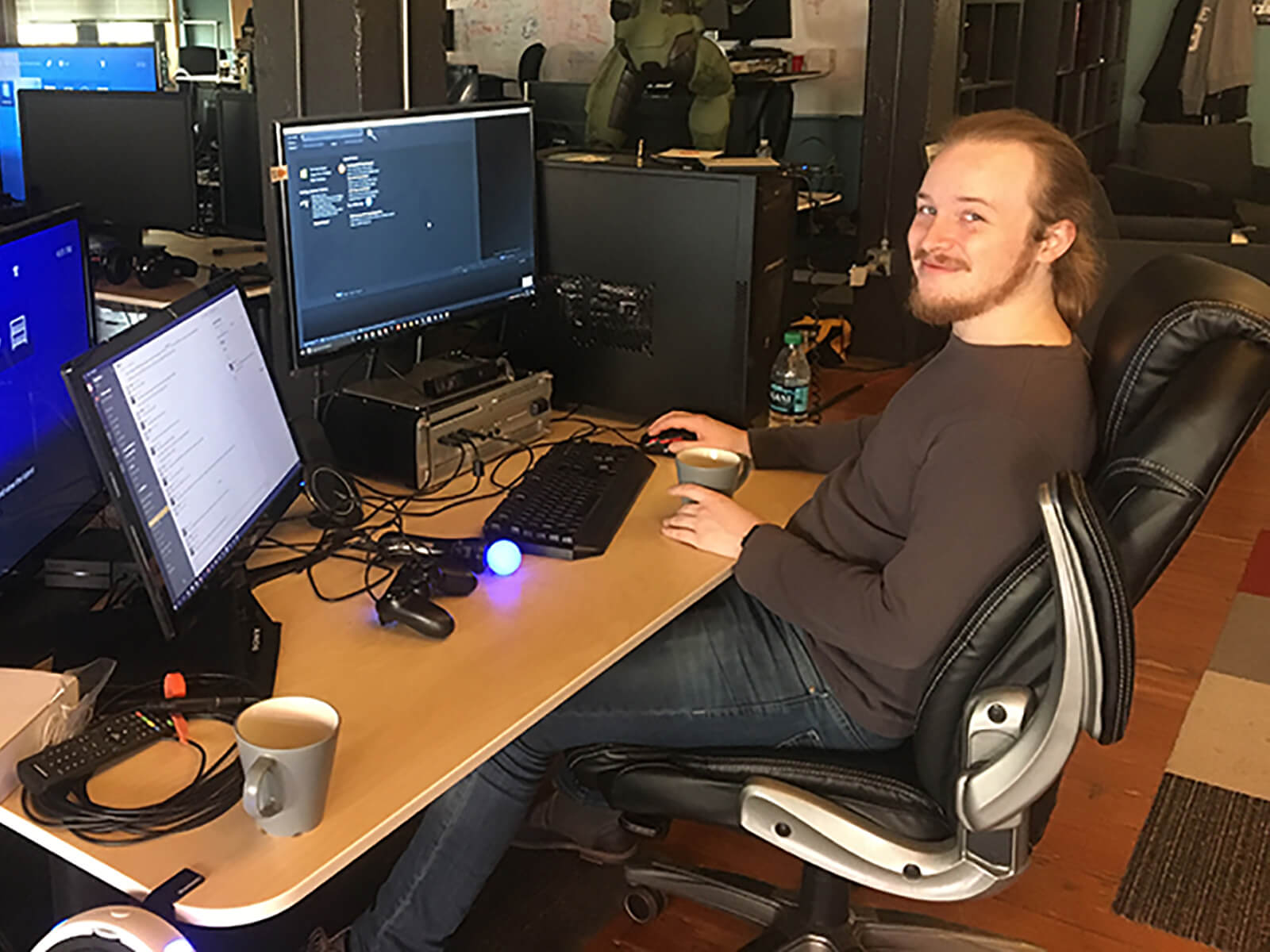 DigiPen alumnus Ian Shores sits at his desk at the Highwire Games office