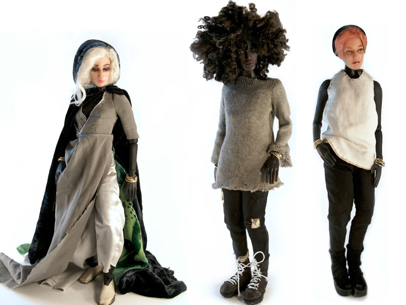 Isabel's action figures are dramatically swathed in layers of natural fabric