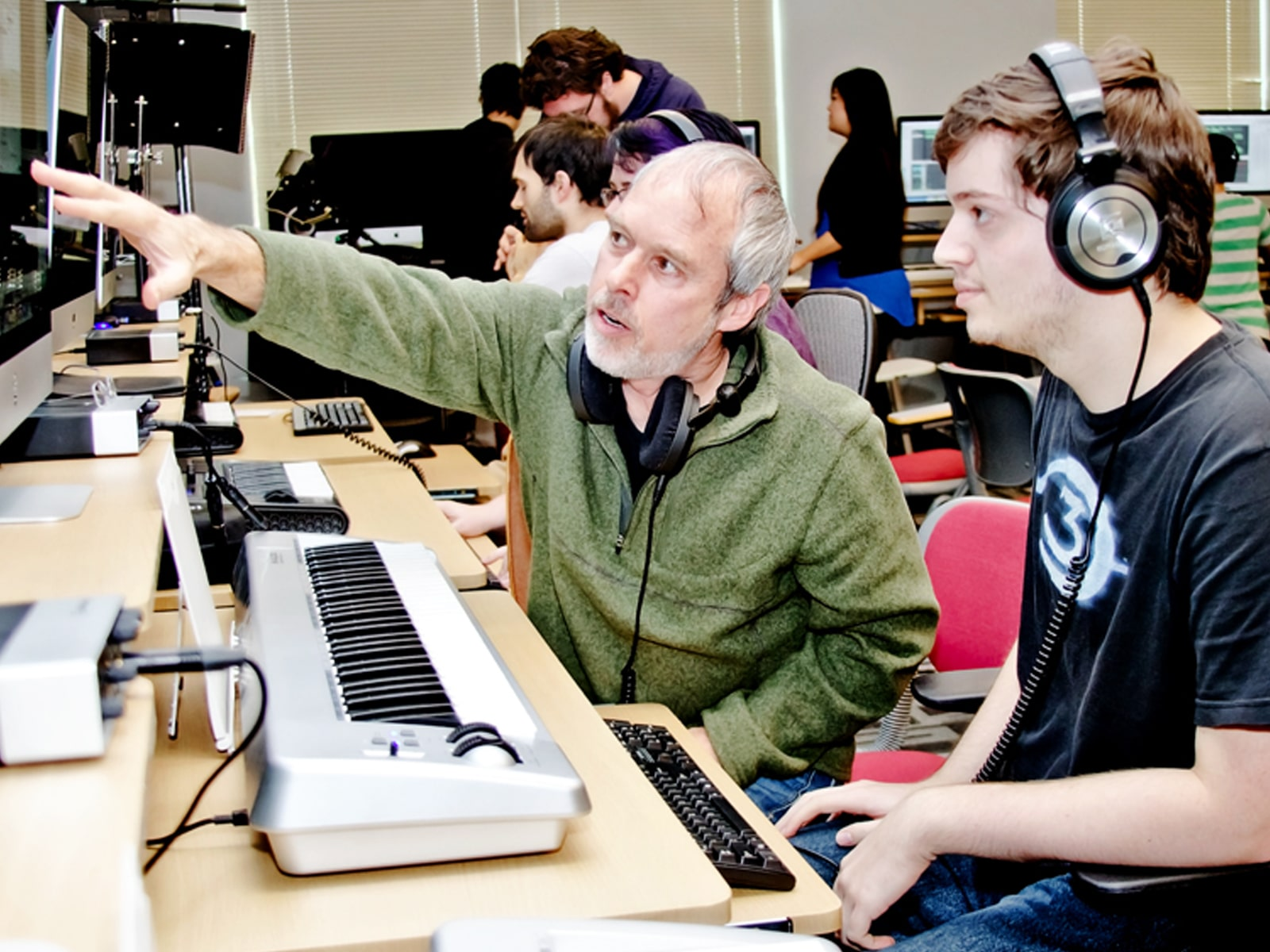 DigiPen music professor Lawrence Schwedler working with a DigiPen student in the new sound lab