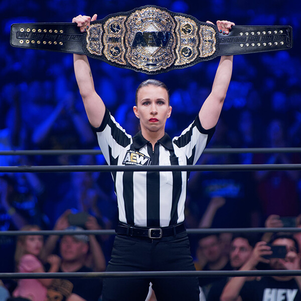 Referee Aubrey Edwards presents the AEW Championship Belt at All Out.