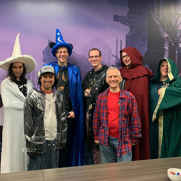 Corey Bowen and fellow Council of Colors members pose wearing variously colored wizard robes.