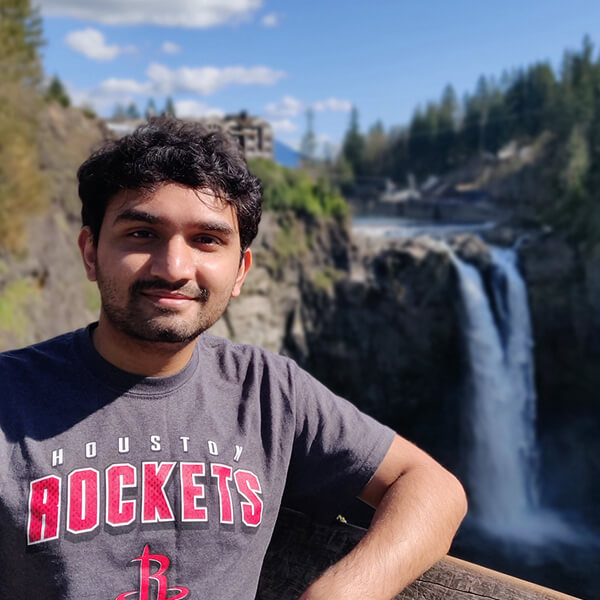 DigiPen MS in Computer Science graduate Dhrumil Shukla poses in front of Snoqualmie Falls